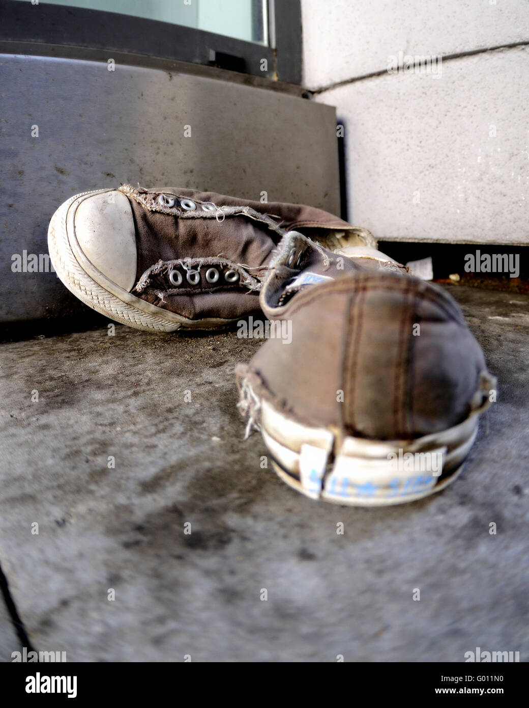 Shoes worn off - Stock Image