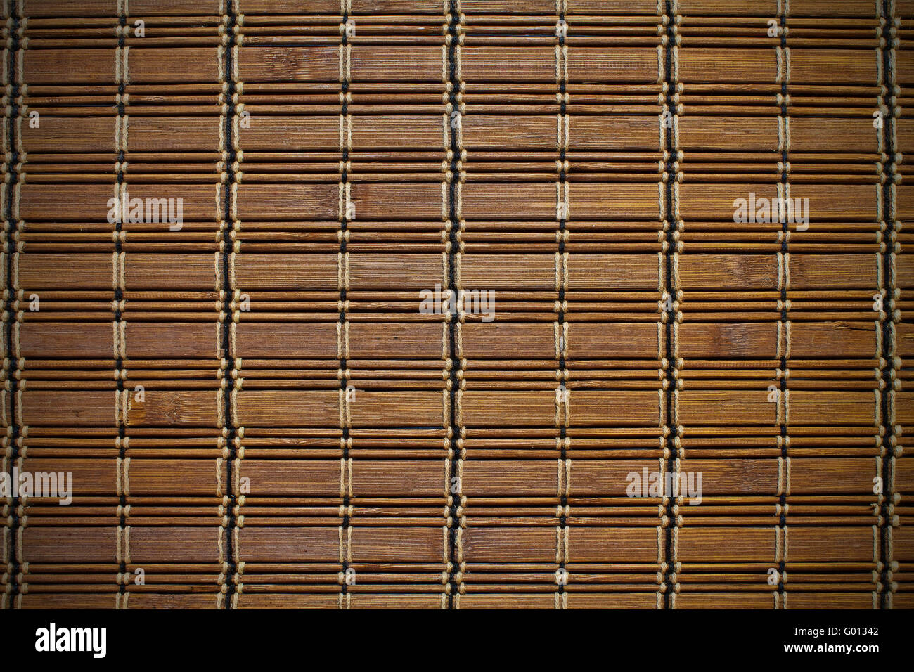 background bamboo mat brown with braid - Stock Image