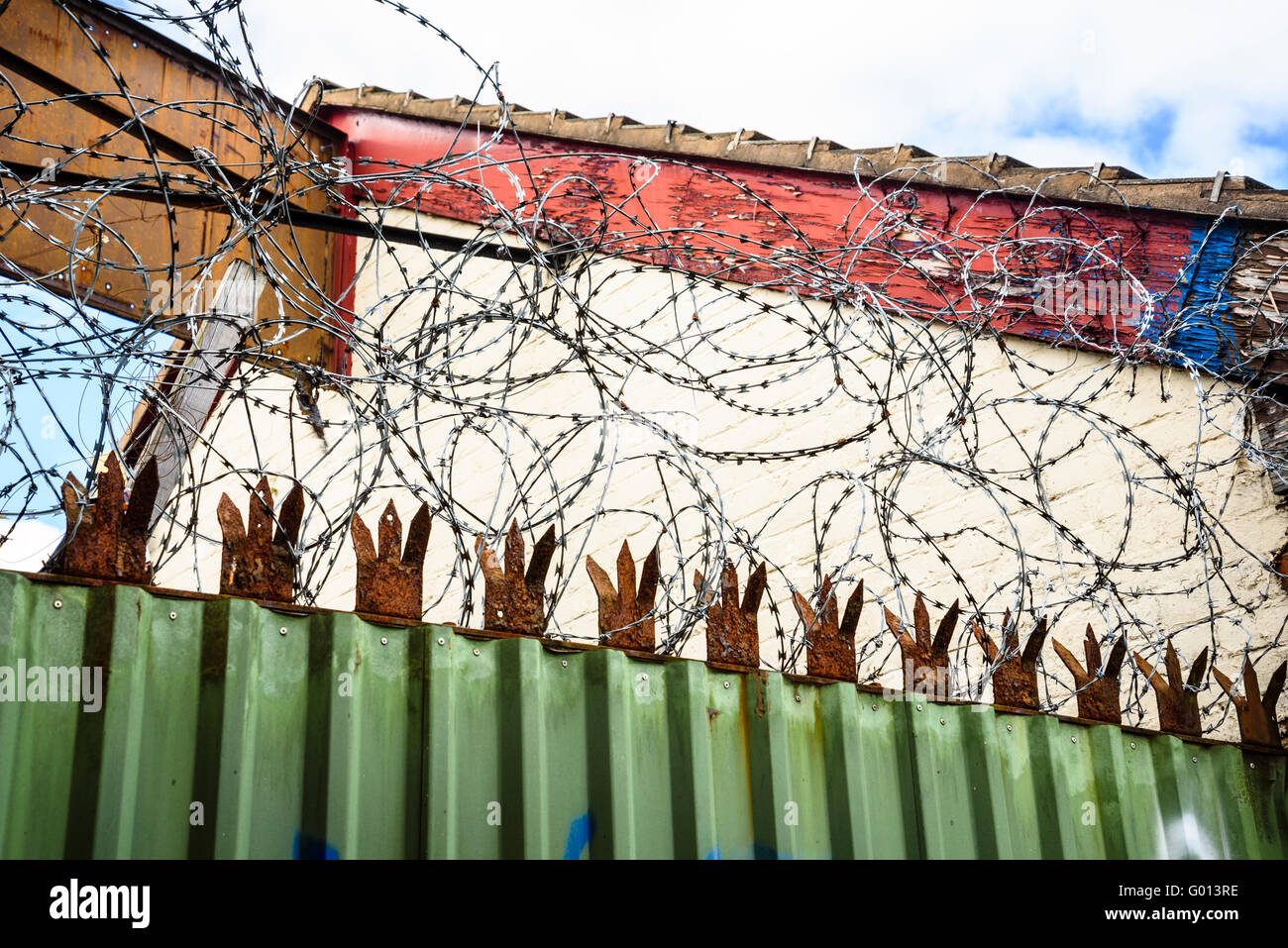 Razor wire on premises alongside the Leeds and Liverpool Canal in Wigan Greater Manchester UK - Stock Image