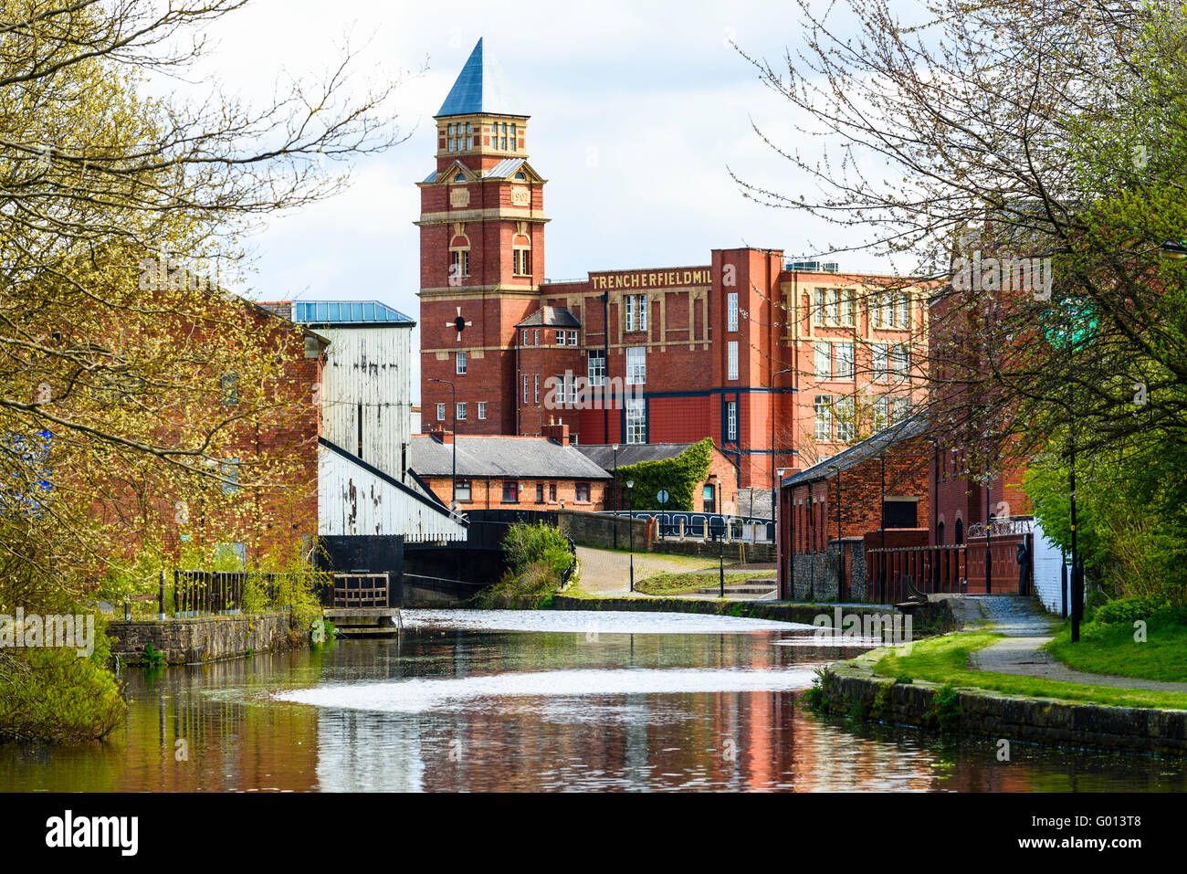 The Leeds and Liverpool Canal looking towards Wigan Pier and Trencherfield Mill in Wigan Greater Manchester UK - Stock Image