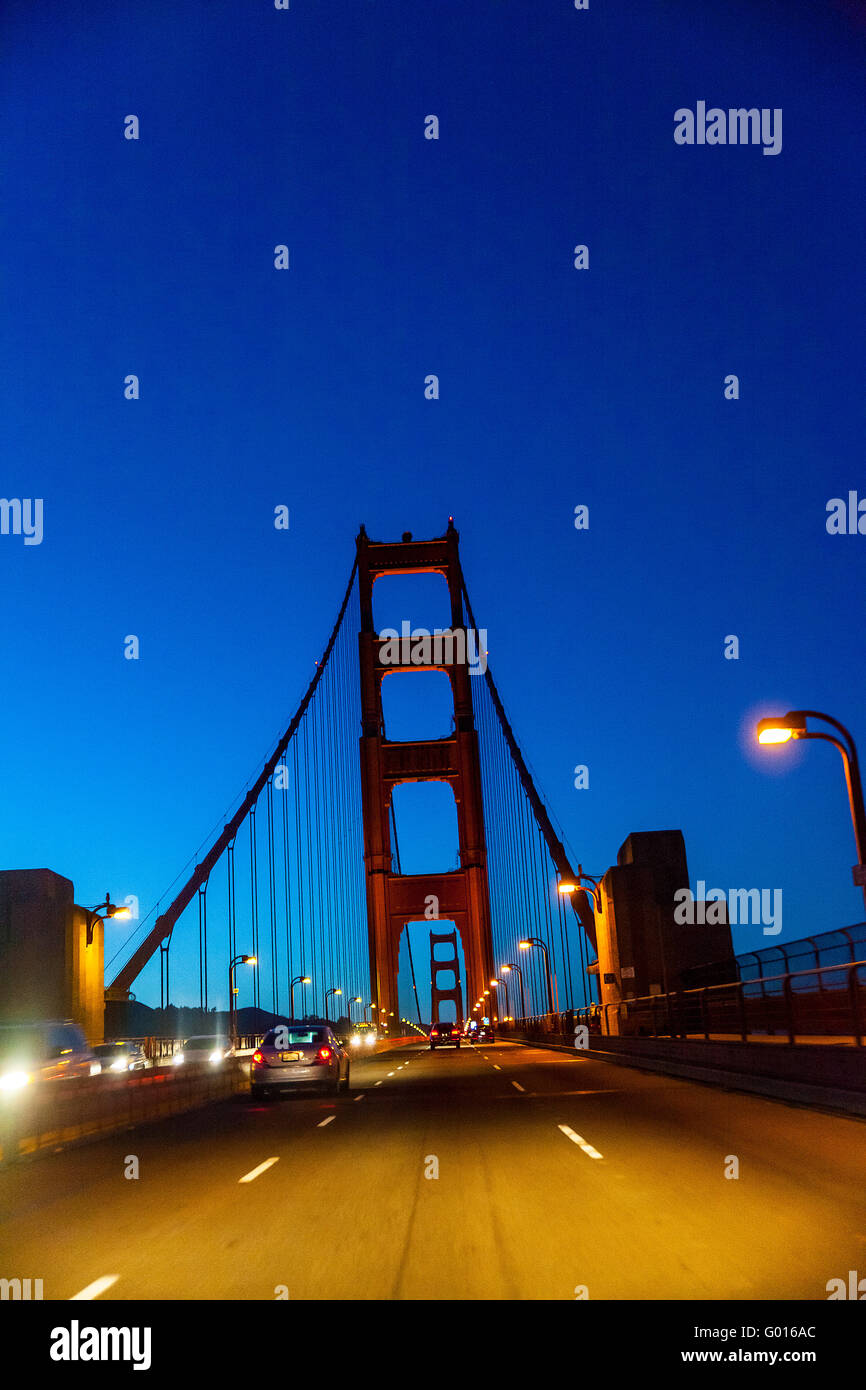 Crossing the Golden Gate Bridge at night just after sunset - Stock Image