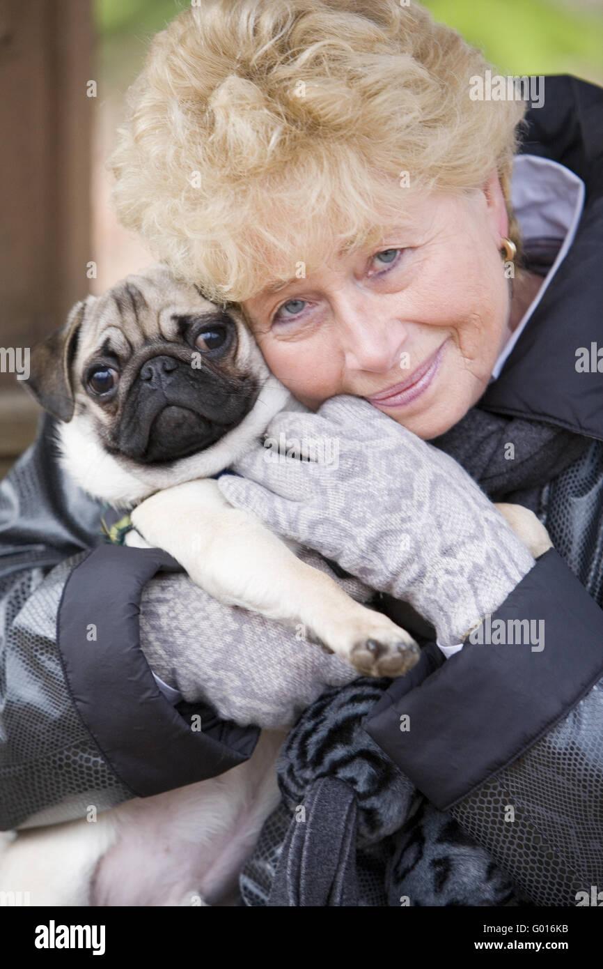 senior with pug - Stock Image
