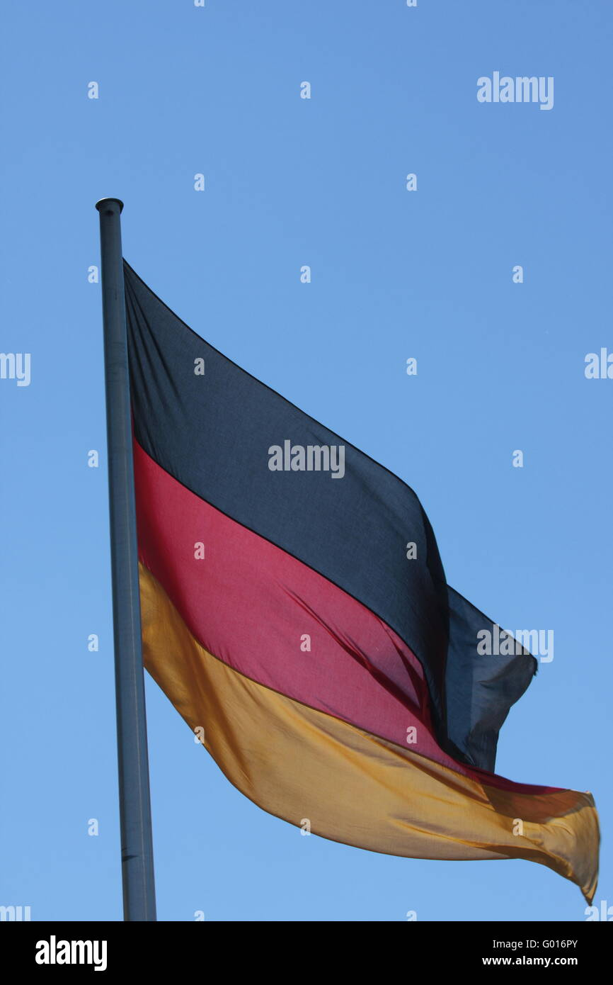german flag in the wind outdoors on a sunny day - Stock Image