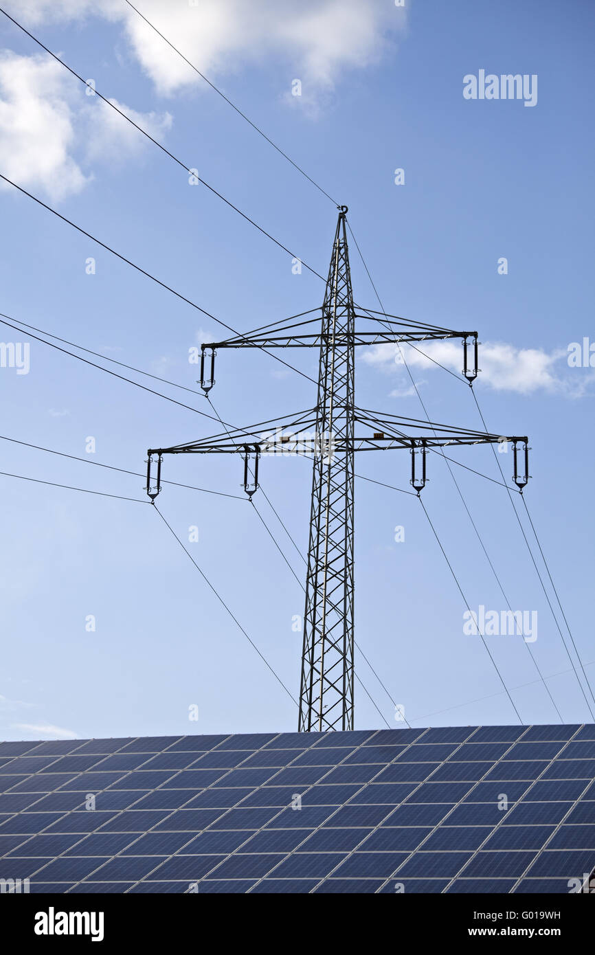 solar panels and a pylon on a sunny day - Stock Image