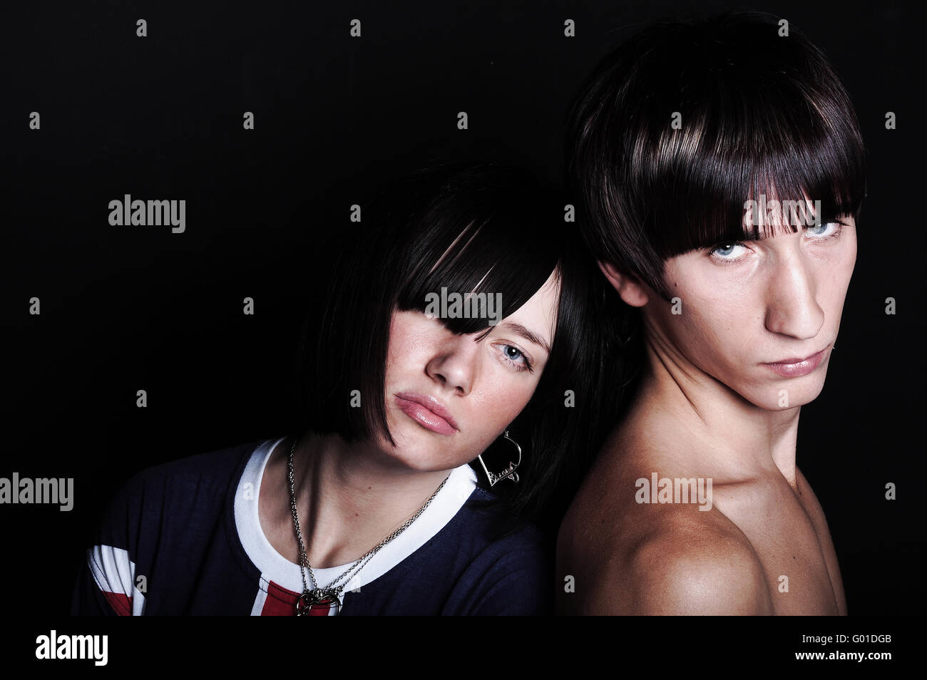 Cute young couple with fashion haircut, on black Stock Photo