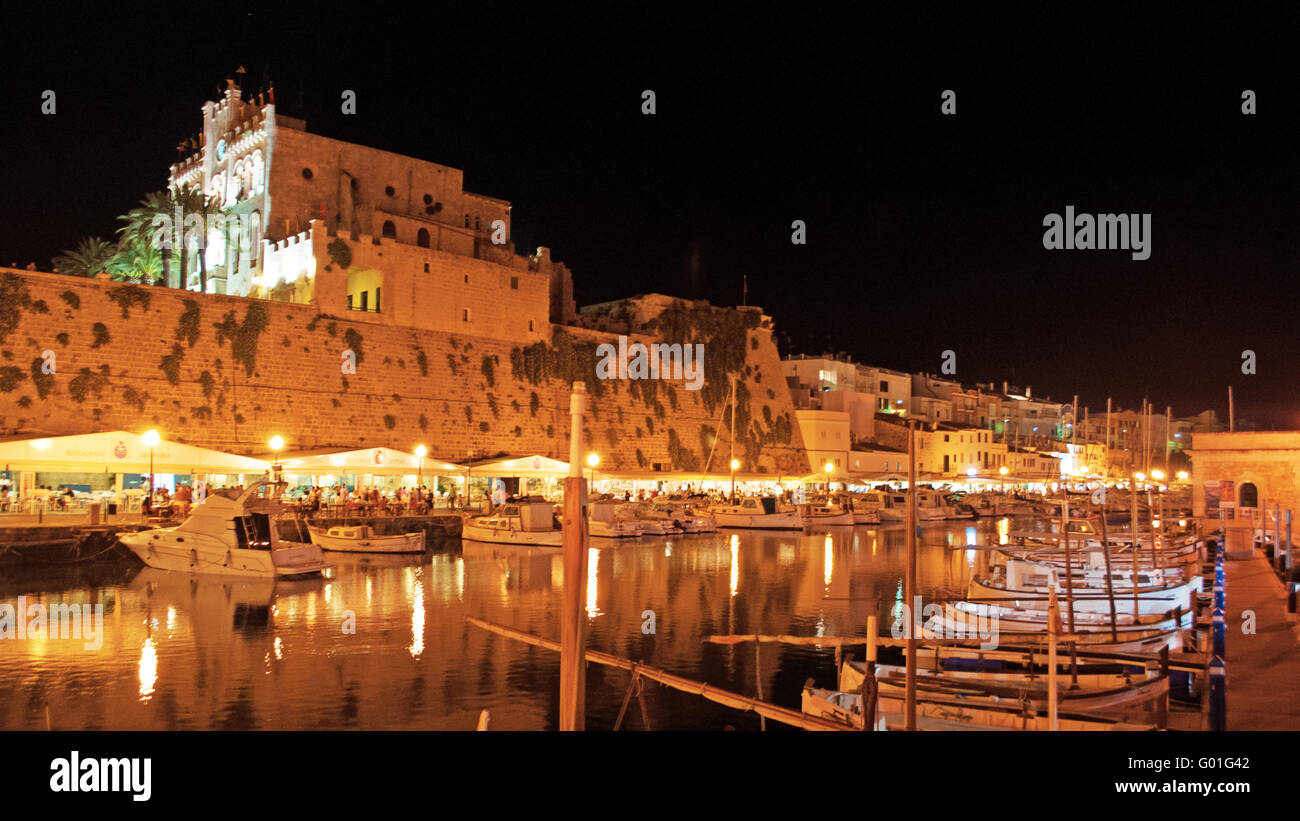 Menorca, Balearic Islands, Spain, Europe: skyline and panoramic night view of the port and the ancient walls of - Stock Image