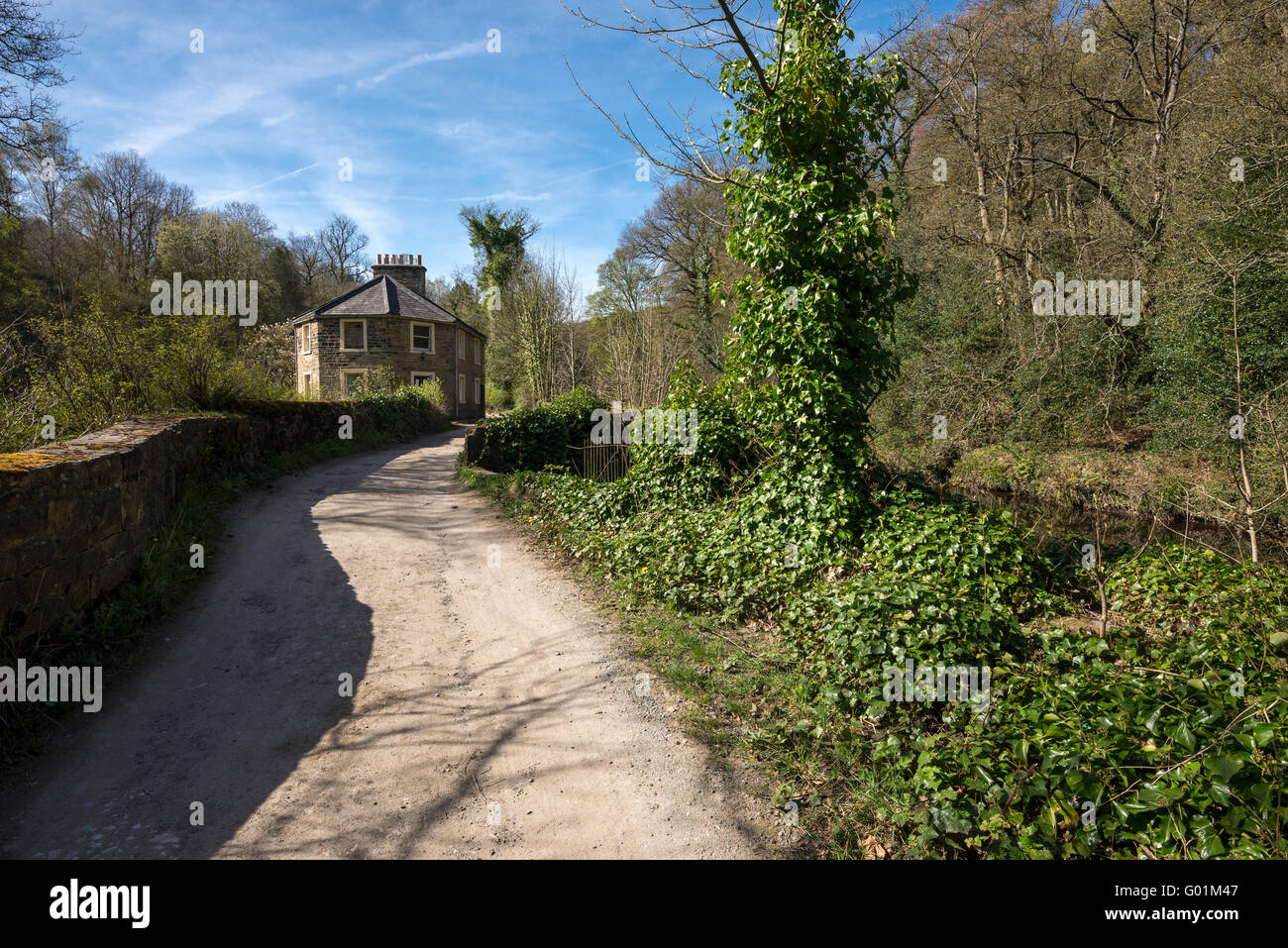 Old cottage beside the river Goyt near Marple, Stockport. A sunny spring day. Stock Photo