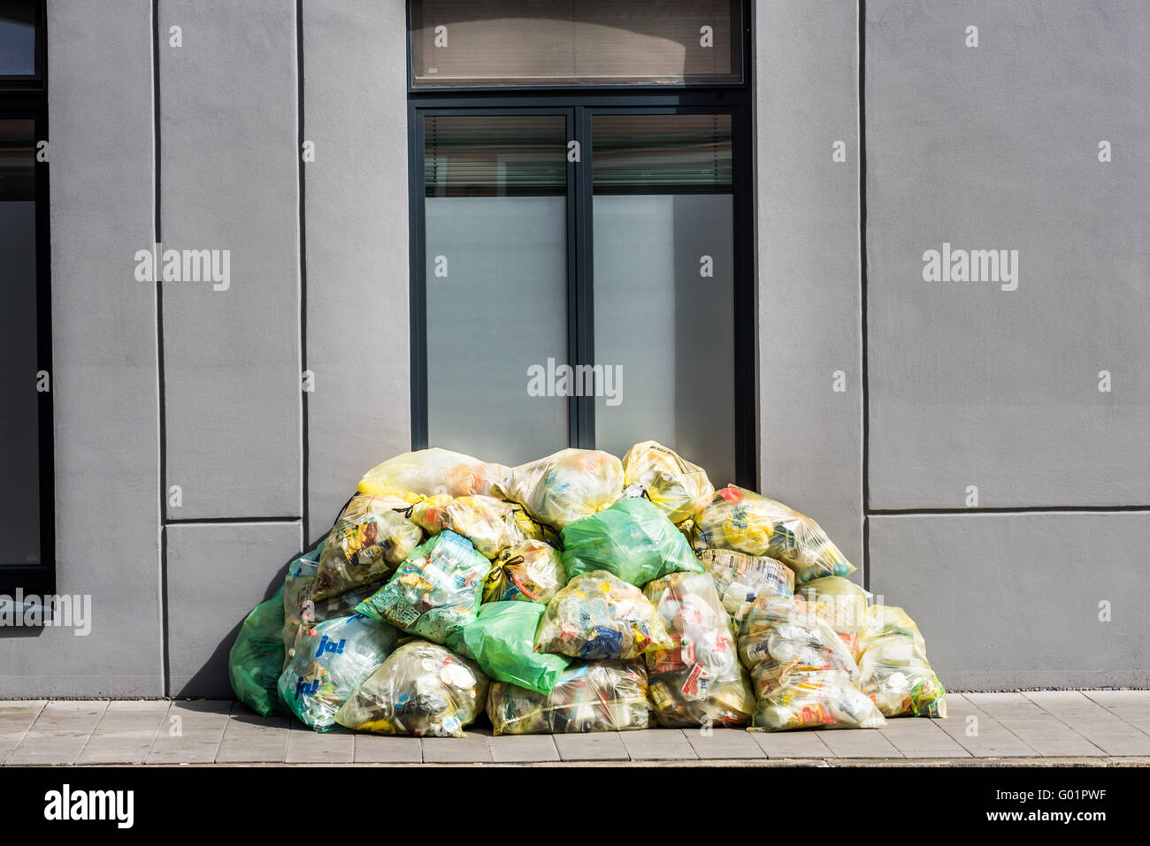collect garbage, separate, recycle, recycling, garbage bags stack picking up outside the house, building, garbage - Stock Image