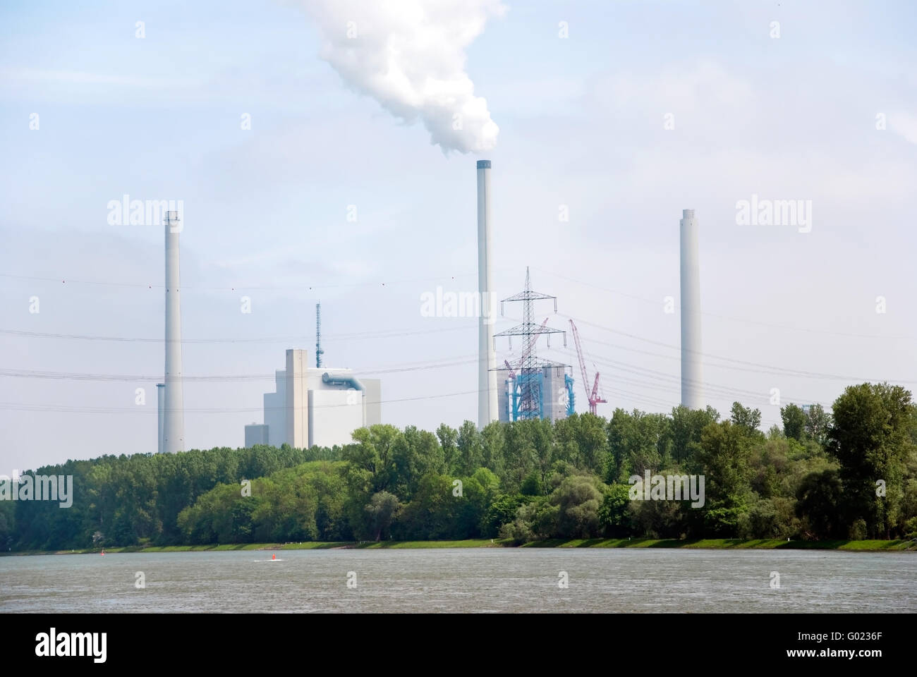 steam power plant and the river rhine in germany - Stock Image