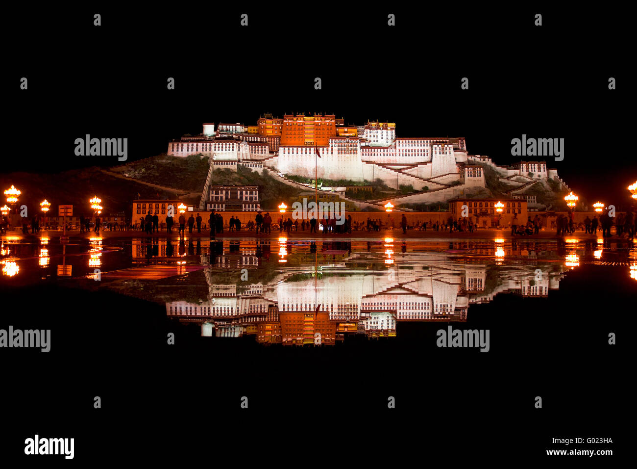 Potala Palace and reflection in pool of water. - Stock Image