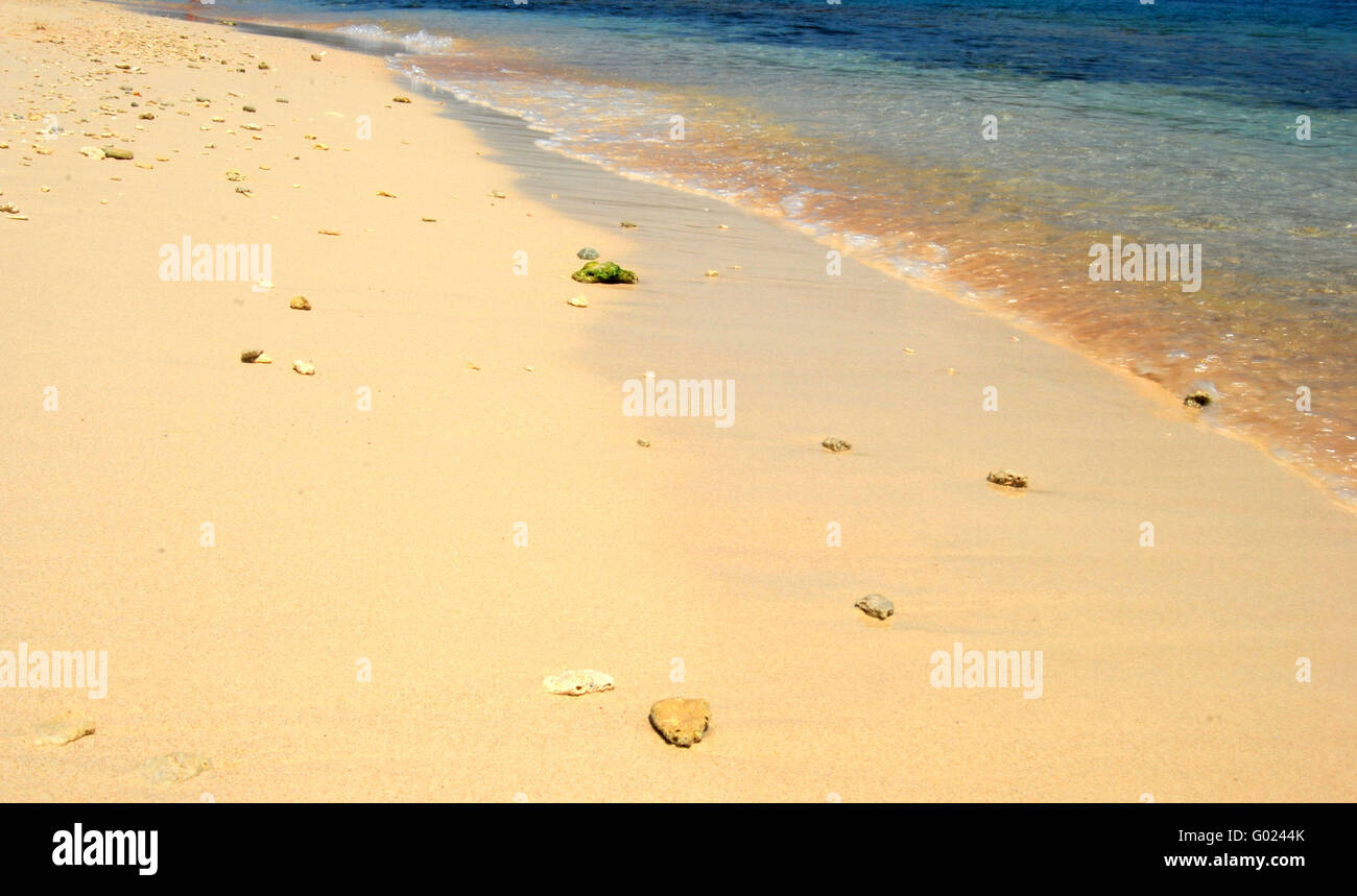 Sand and water on a tropical beach - Stock Image
