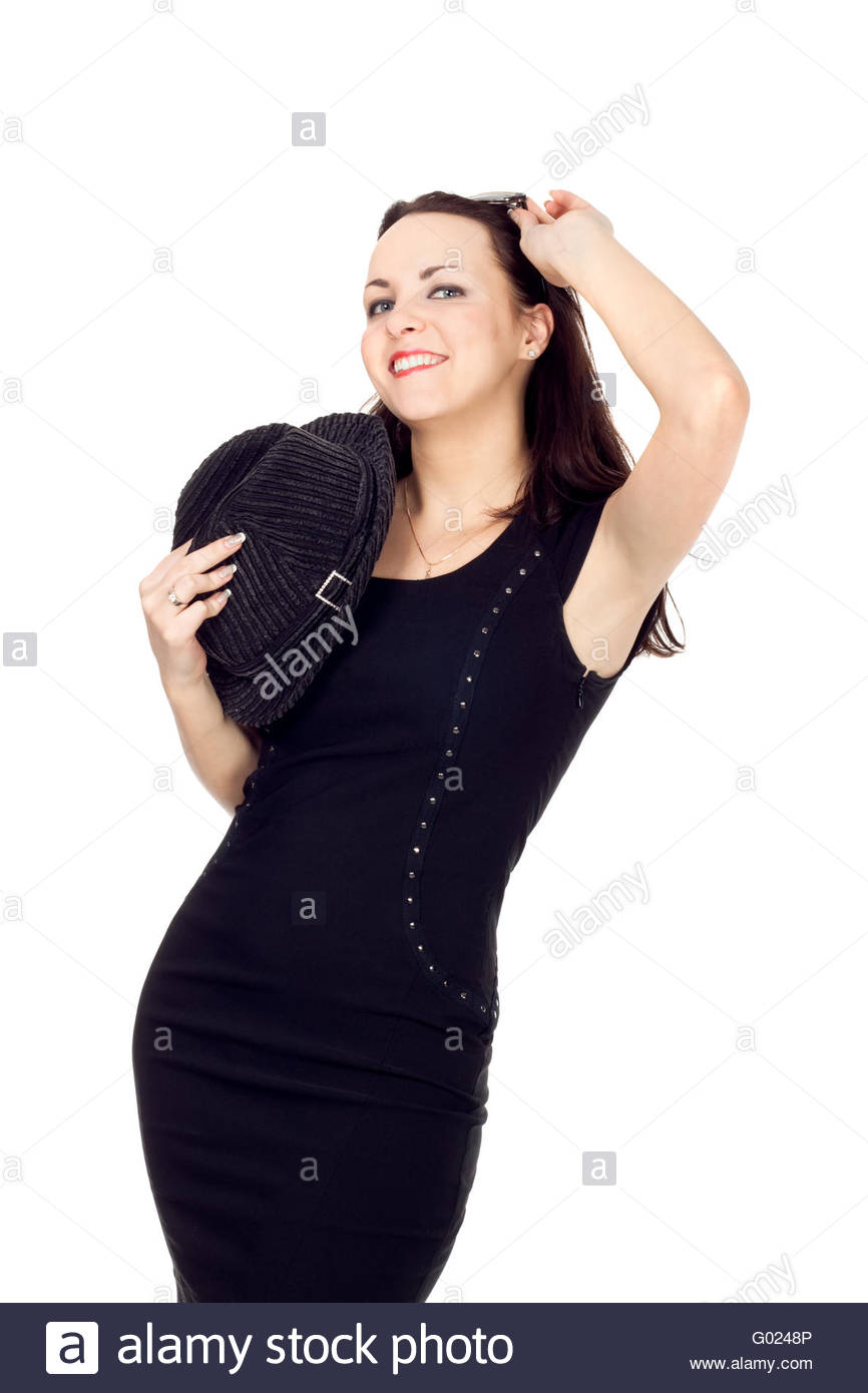 young woman in a black minidress with a hat in hand - Stock Image