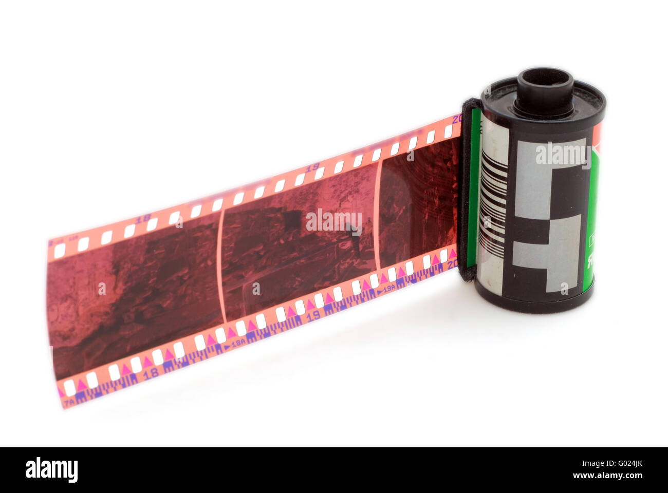 35 mm negative film and roll isolated in white background - Stock Image