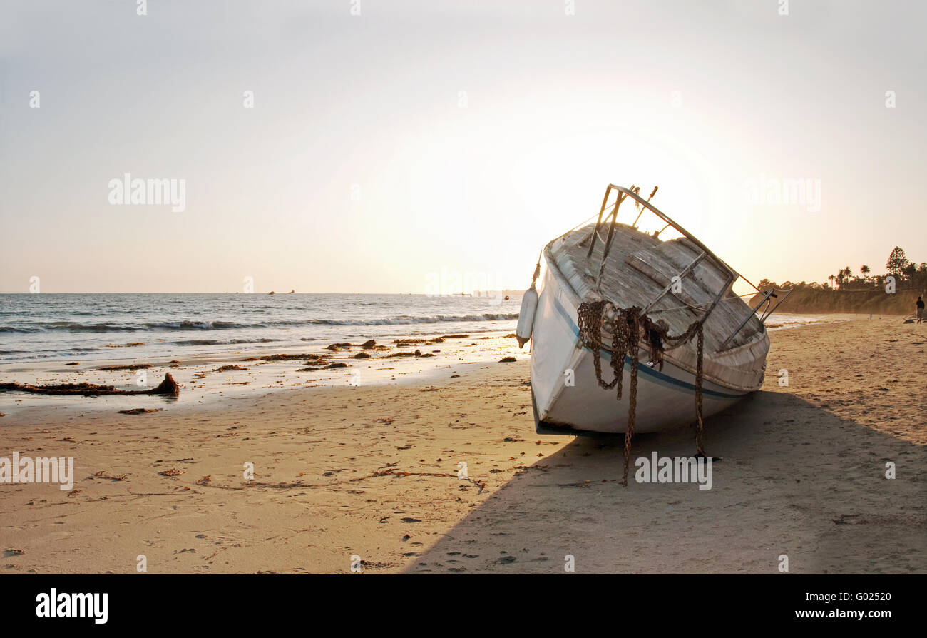 sail boat abandoned on beach in santa barbara - Stock Image