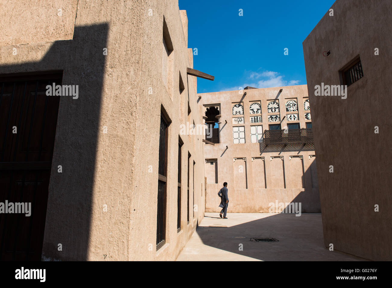 Man walking through Old Dubai, UAE. Stock Photo