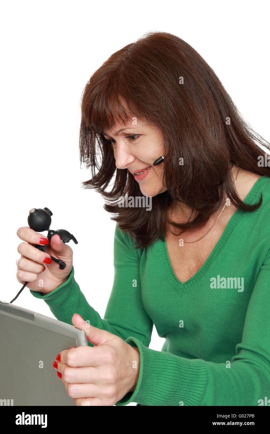 The woman communicates through a web-cam by means of the Internet - Stock Image