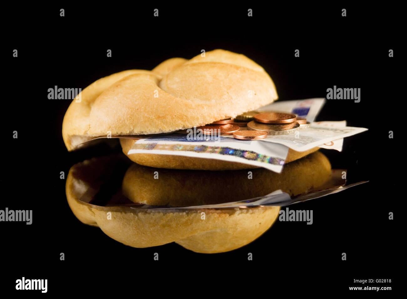 bun with coins - Stock Image
