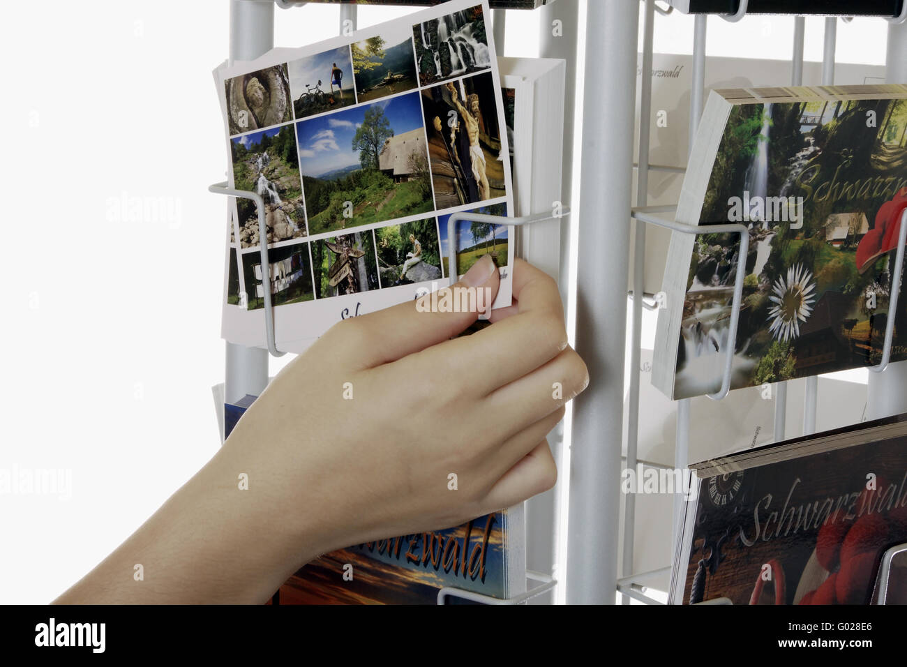 postcards in a rack - Stock Image