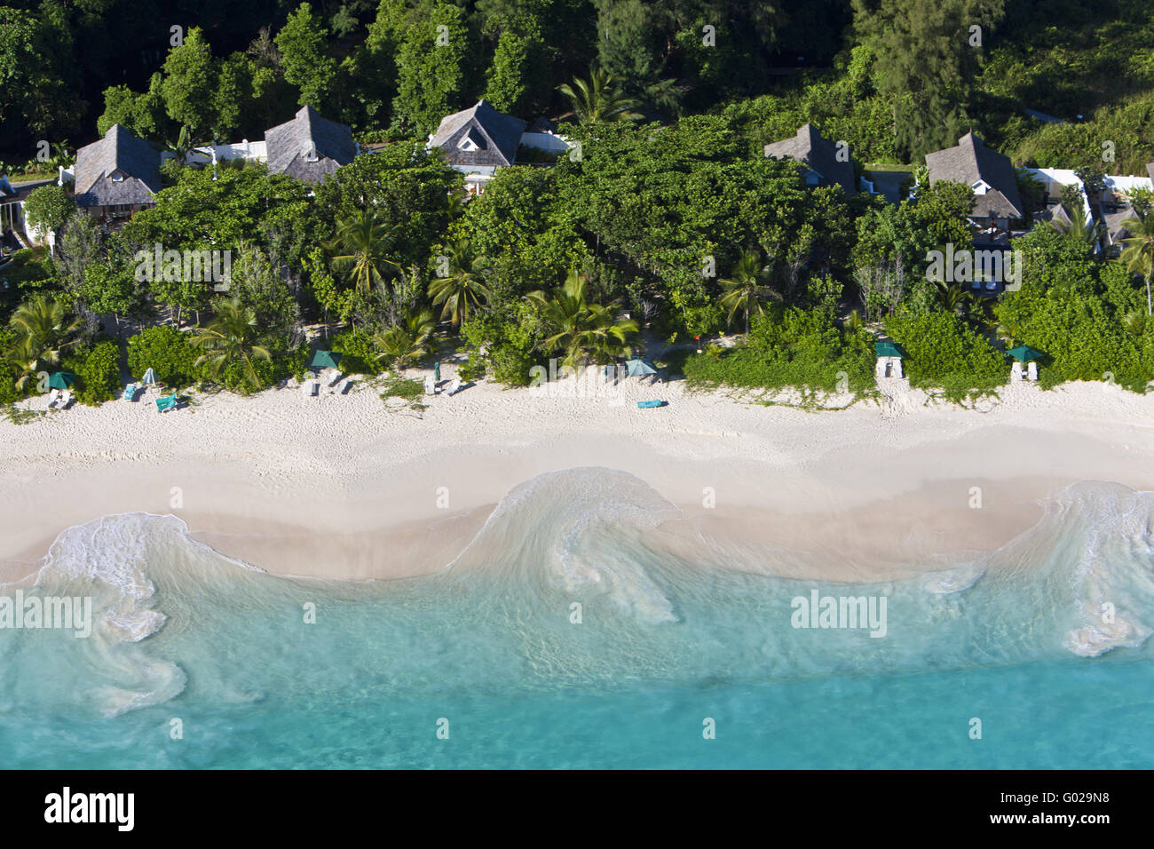 The Banyan Tree Hotel on the beach Anse Intendance - Stock Image