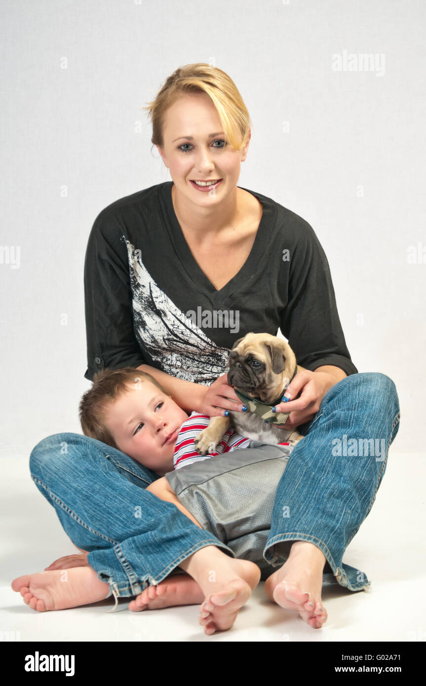Loving the new pet Pug - Stock Image