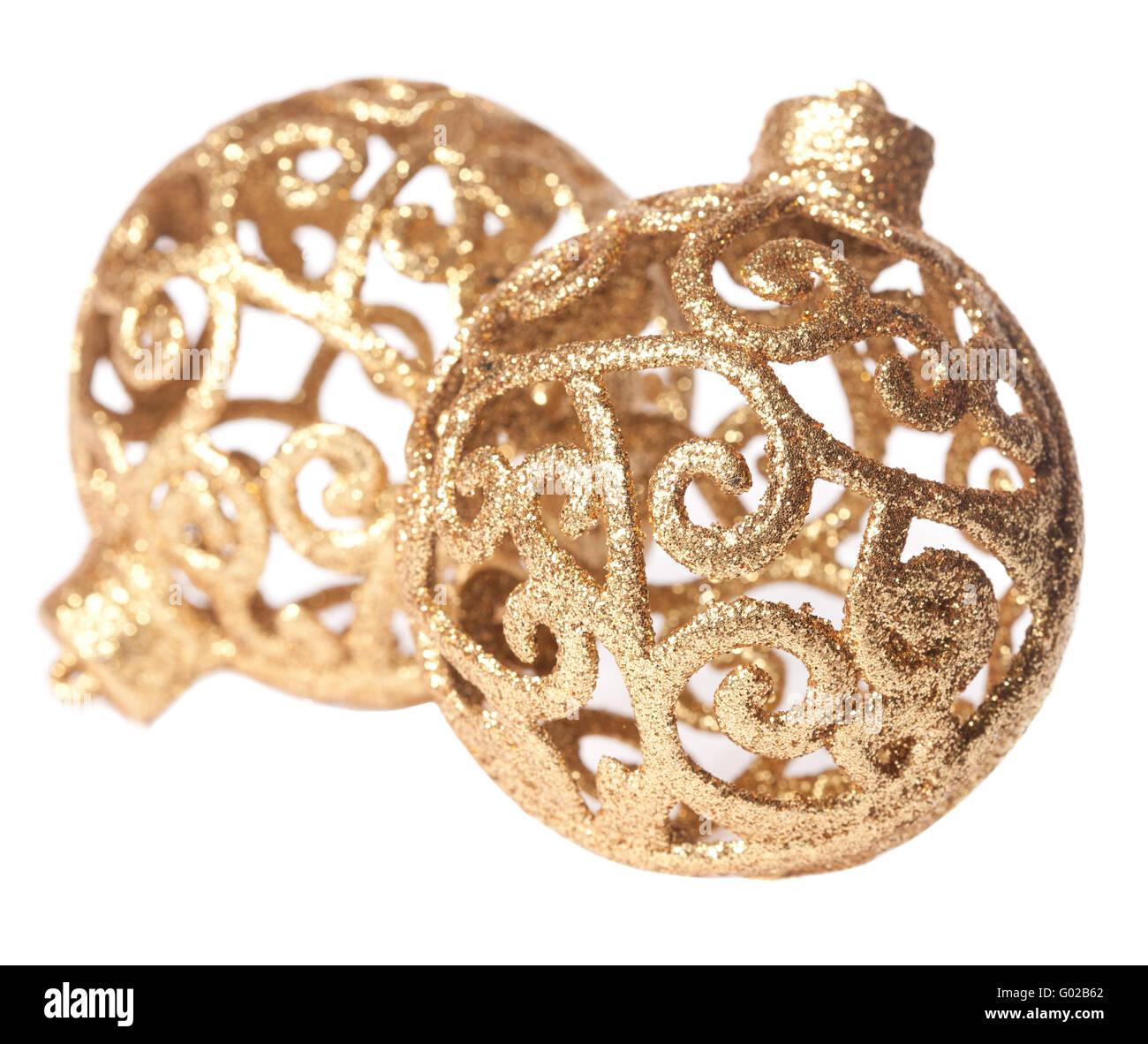 Golden Christmas balls lying on a white background - Stock Image