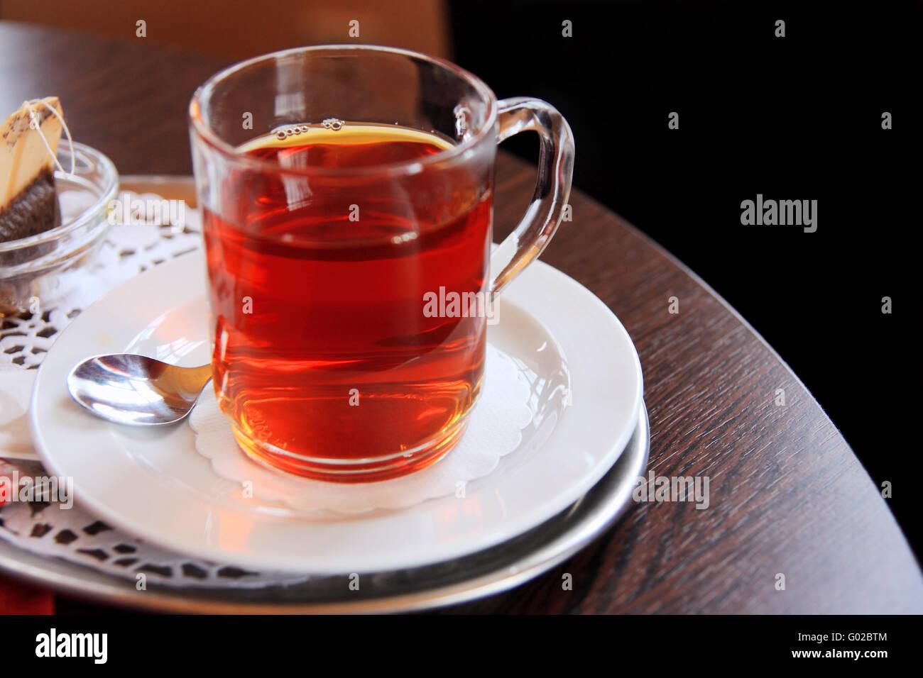 glass of black tea with teabag Stock Photo