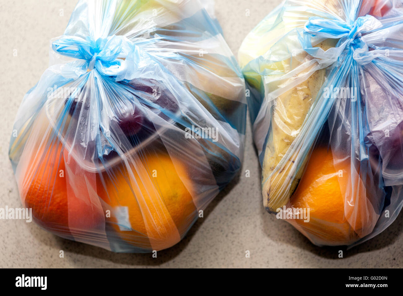 Fruits in two plastic bags - Stock Image
