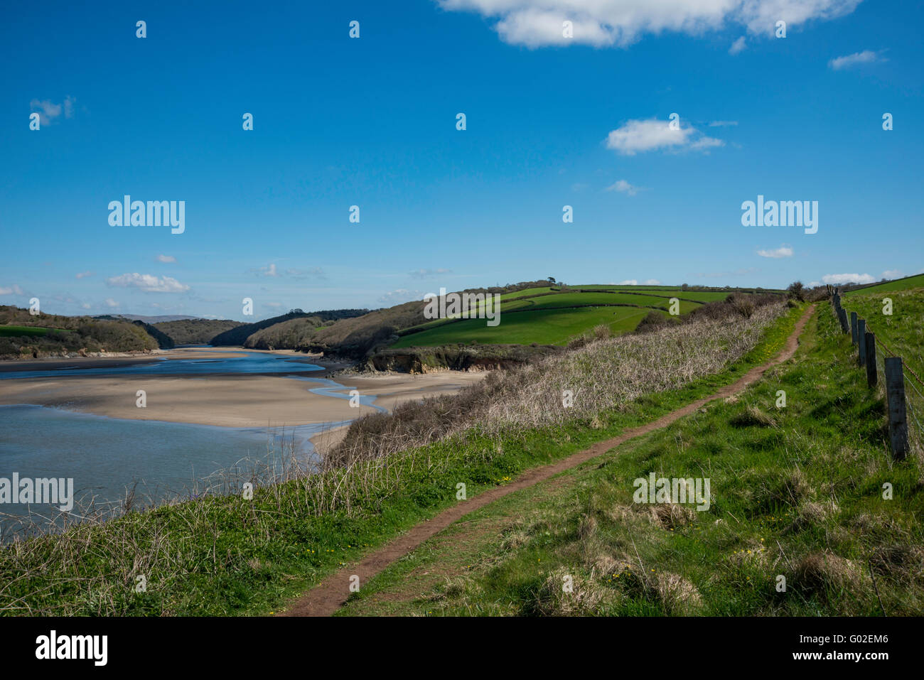 Mouth of the Erme Estuary looking upstream toward Wonwell beach and the South West Coastal footpath. - Stock Image