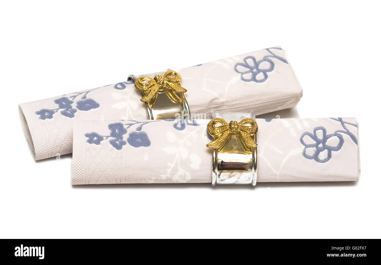 Paper napkin with gold bows on white background - Stock Image