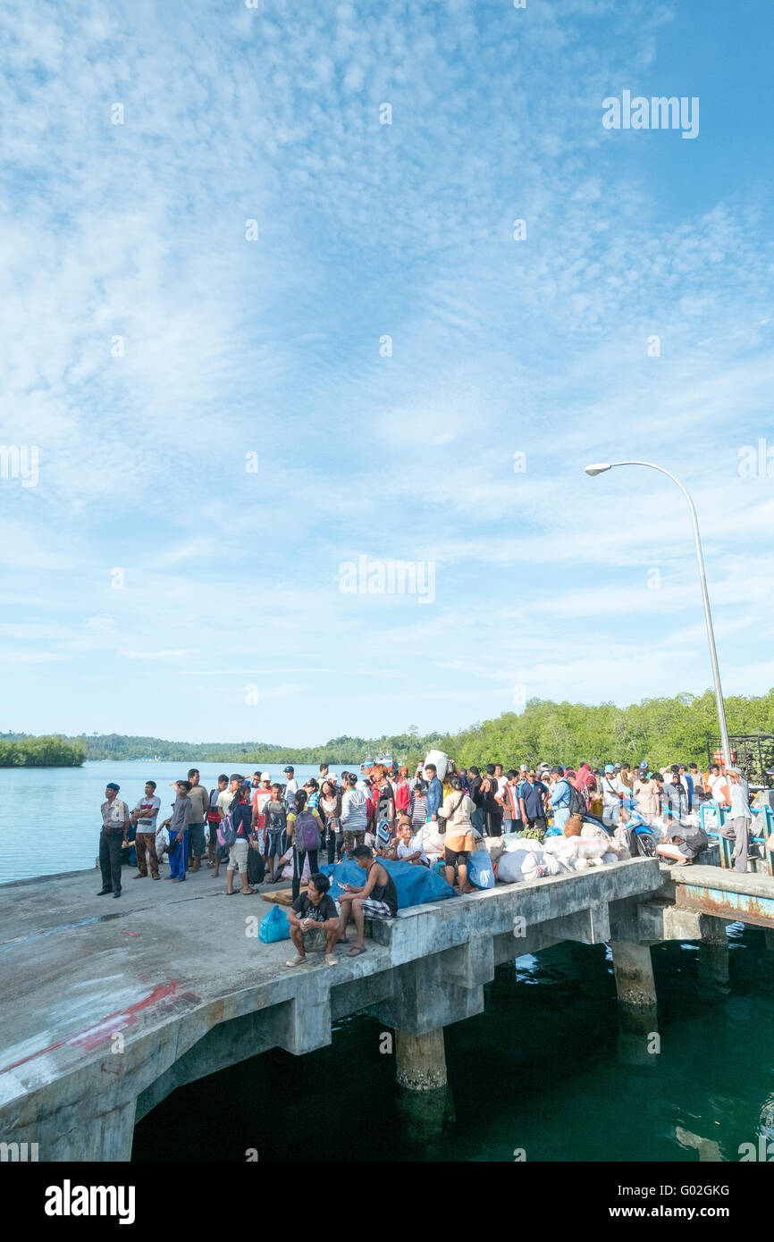 Local people waiting for ferry at the Port of Muara Siberut. - Stock Image