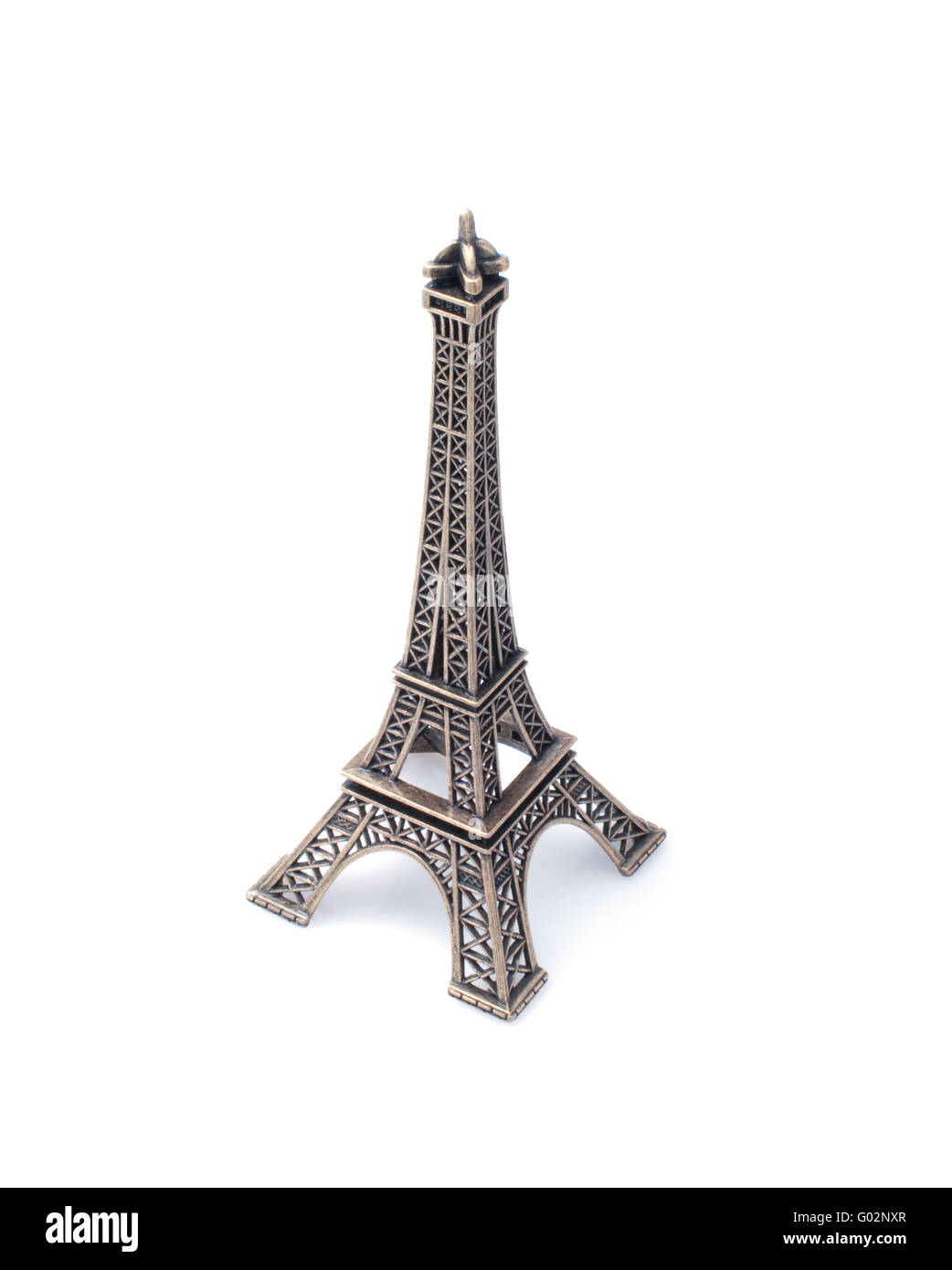 Small  copy of Eiffel tower figurine isolated on white background - Stock Image