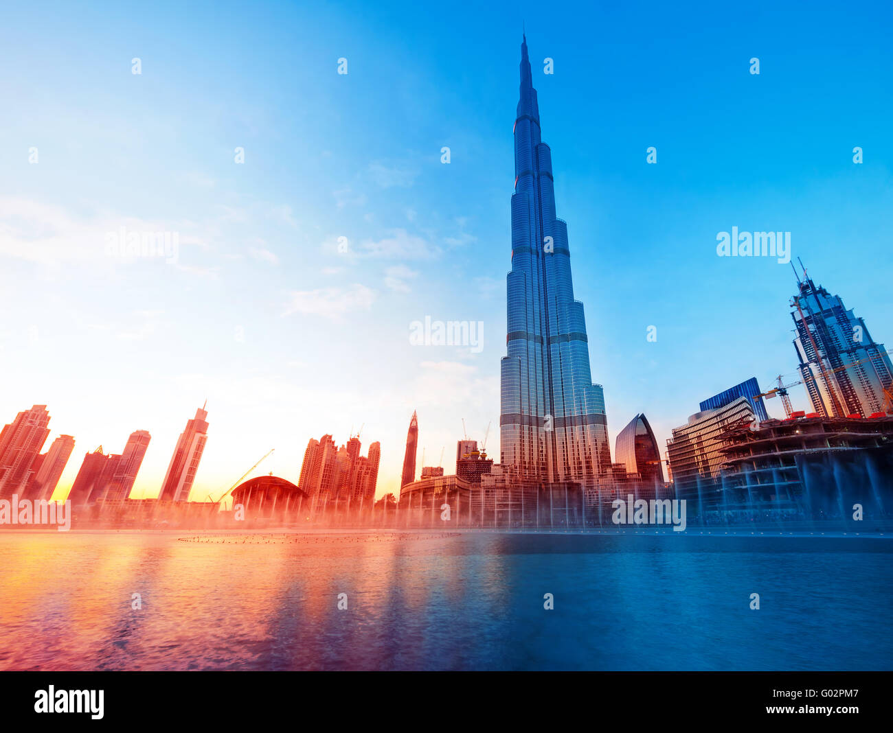 DUBAI, UAE - FEBRUARY 17: Burj Khalifa and fountain - world's tallest tower at 828m at beautiful sunset light - Stock Image