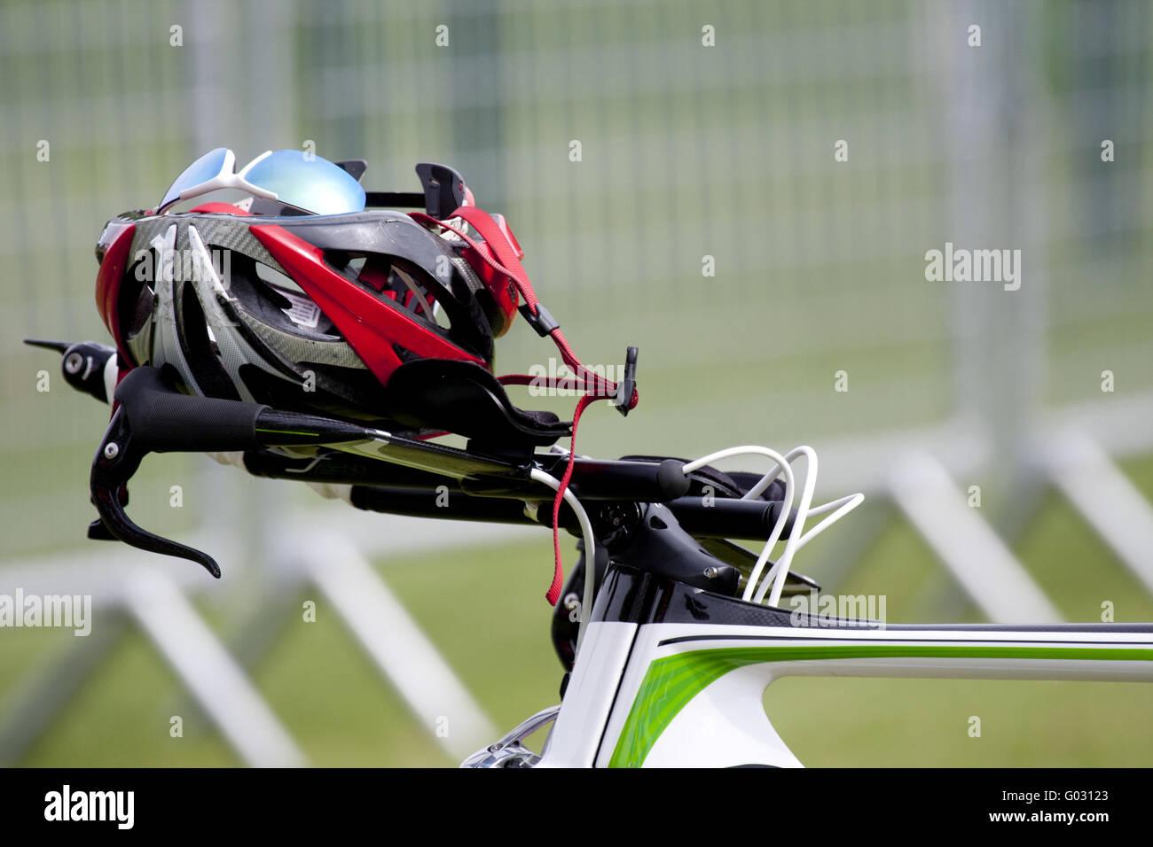 Helmet on the handlebars of a bike - Stock Image