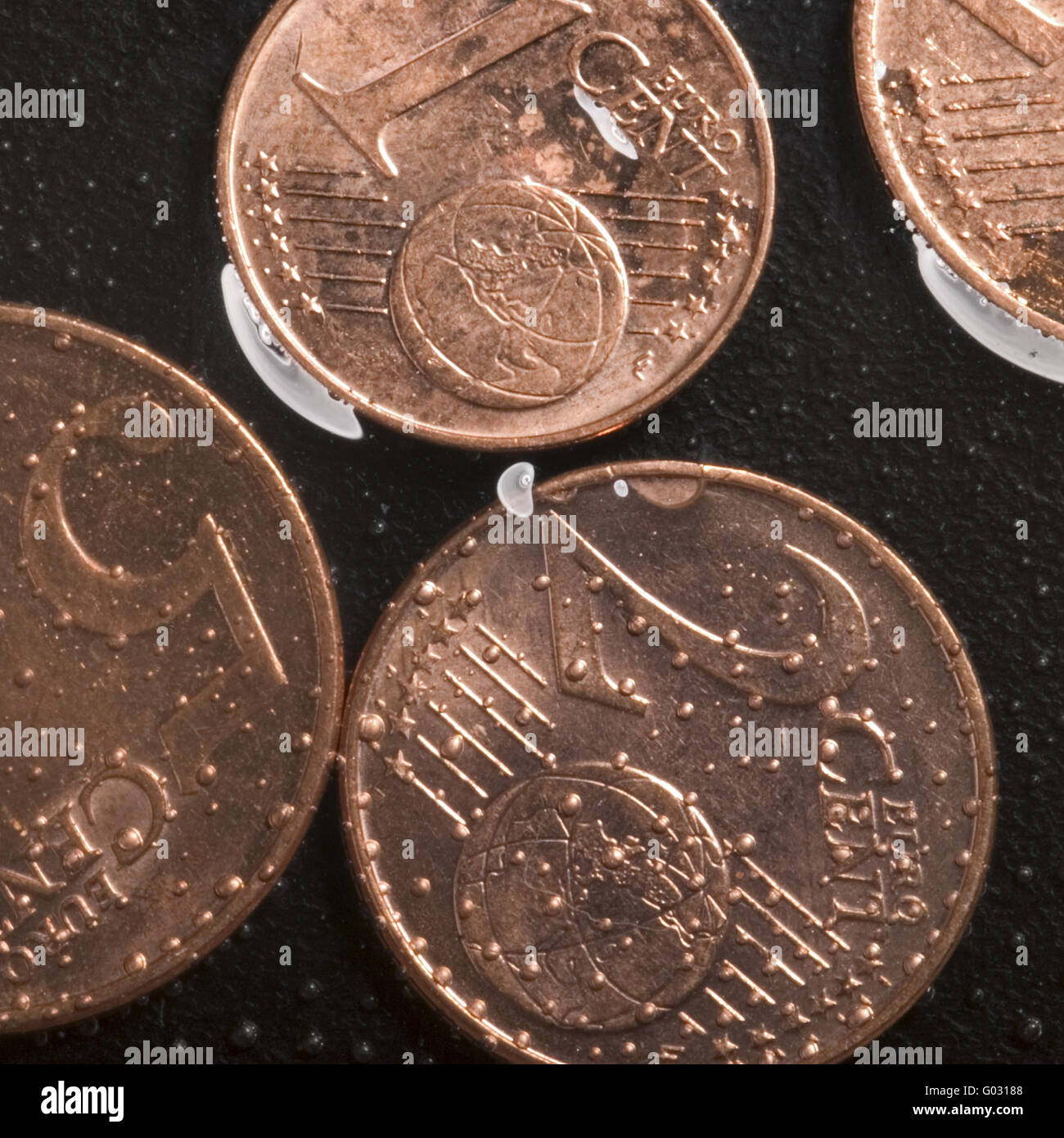 Euro coins in water - Stock Image