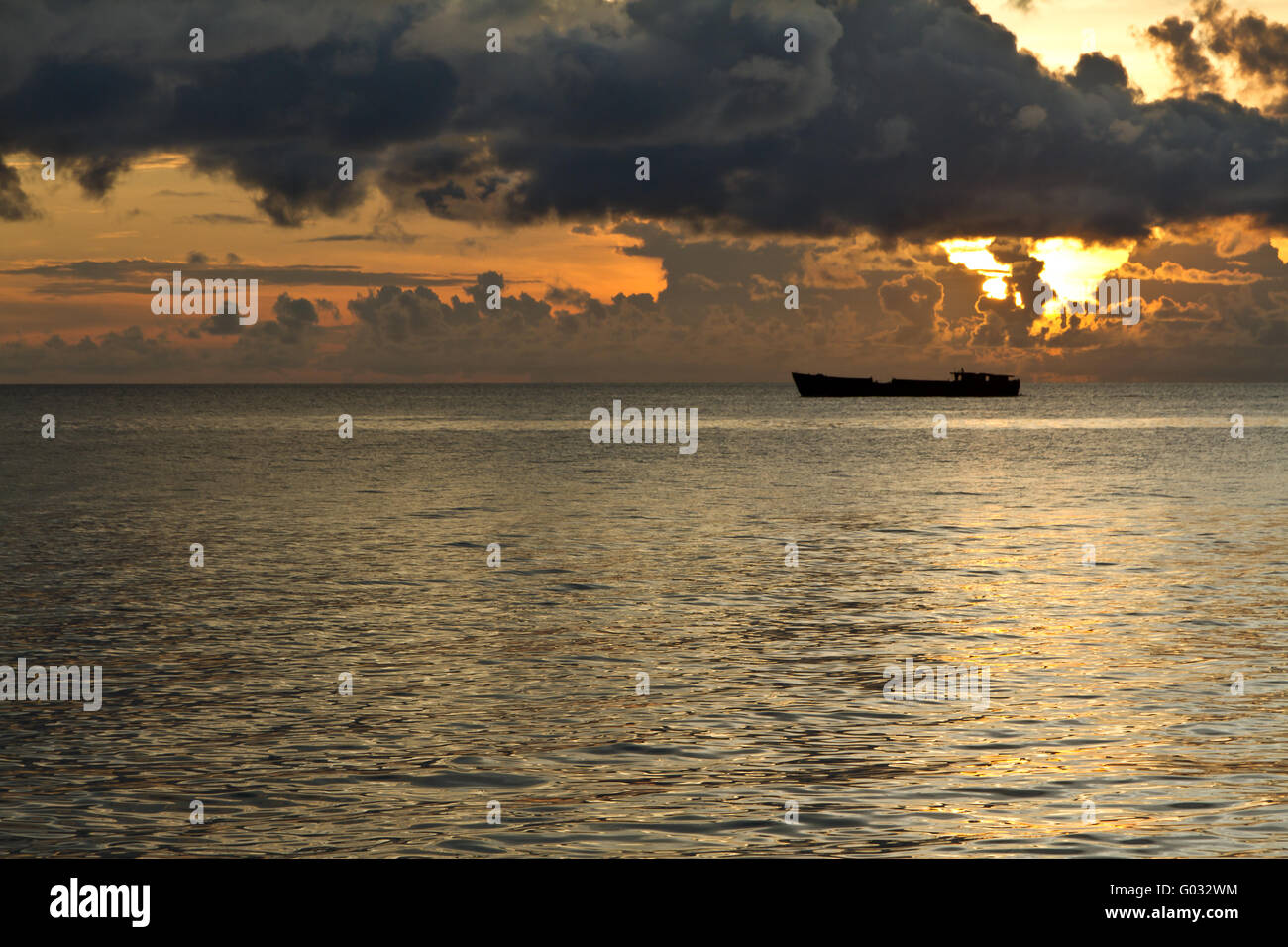 Ship with threatening clouds over South China Sea at Phu Quoc, Vietnam - Stock Image
