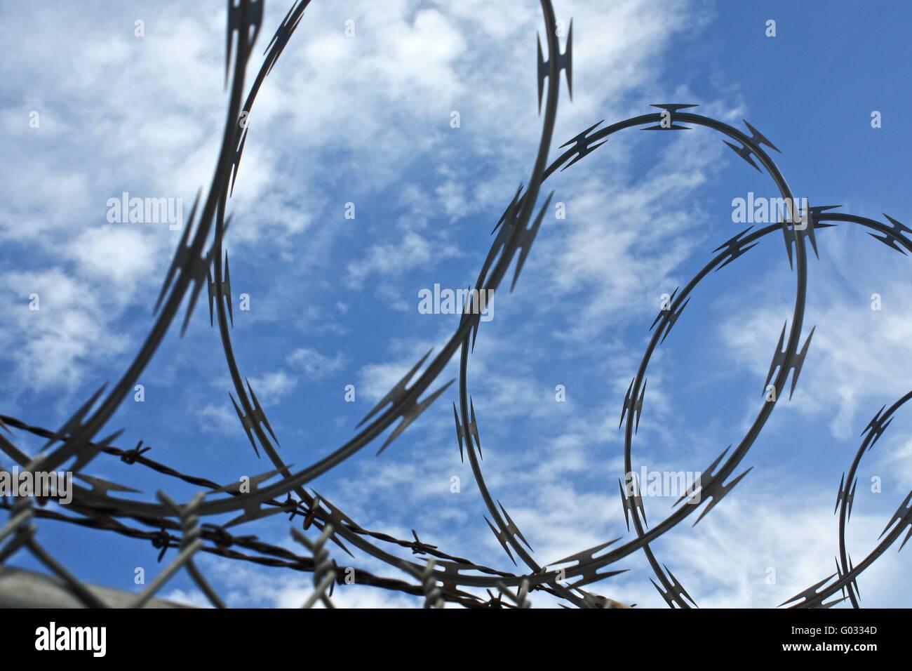 Steel Razor Wire Perimeter Fence Stock Photos & Steel Razor Wire ...