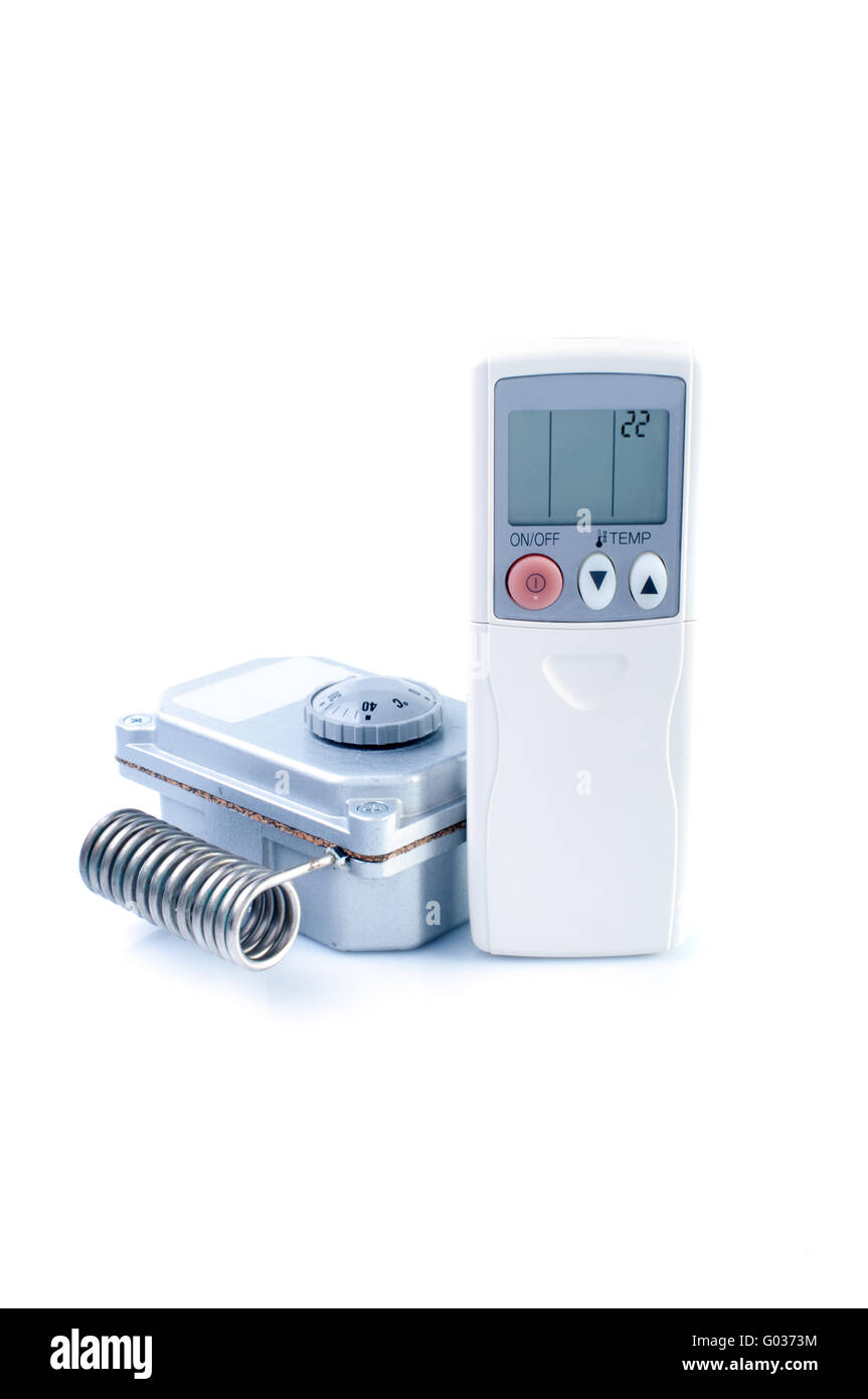 Thermostat and air conditioner remote control  isolated on white background - Stock Image