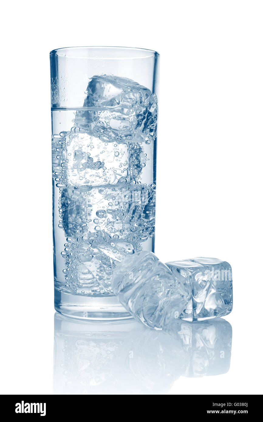 Full glass of fresh cool carbonated water with ice isolated - Stock Image