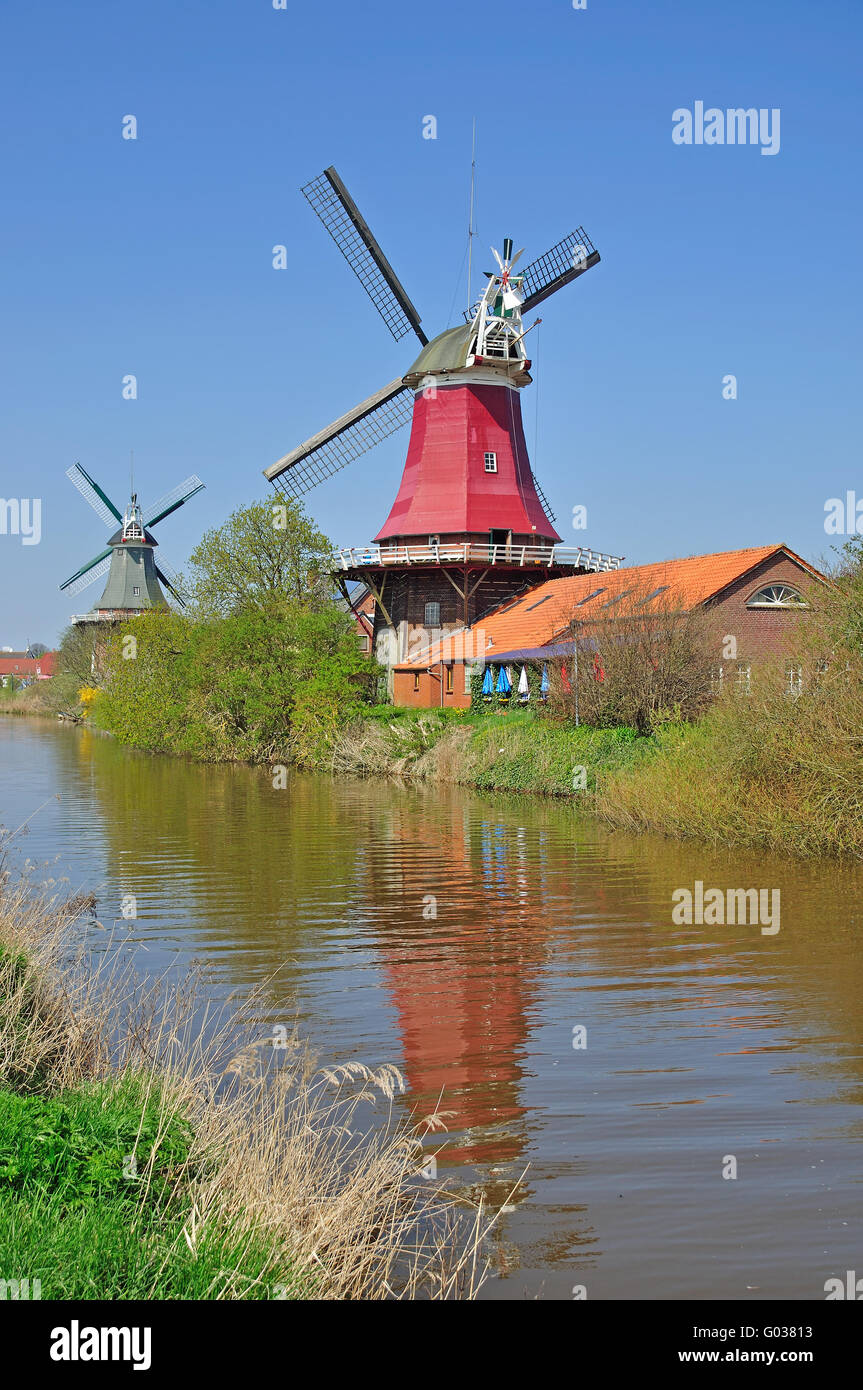 Twin Mills of Greetsiel at the german North Sea - Stock Image