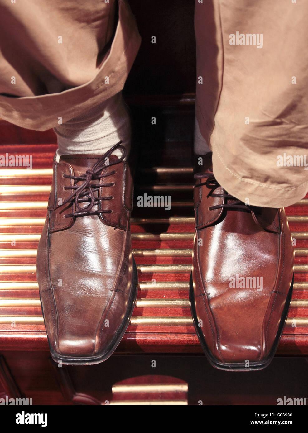 shining shoes - Stock Image