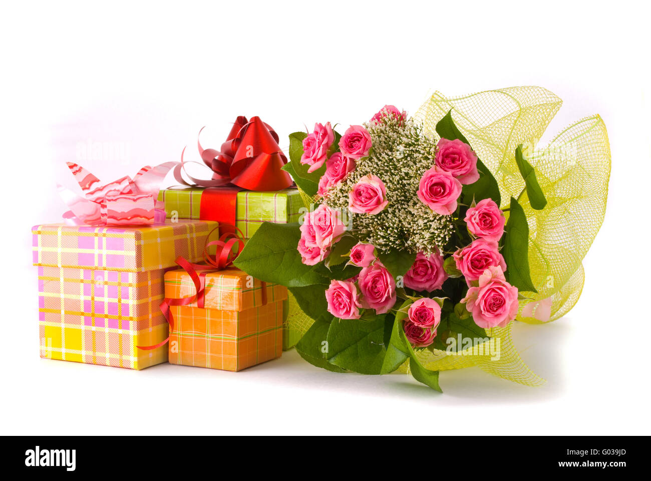 Beautiful roses bouquet and present boxes on white background stock beautiful roses bouquet and present boxes on white background izmirmasajfo