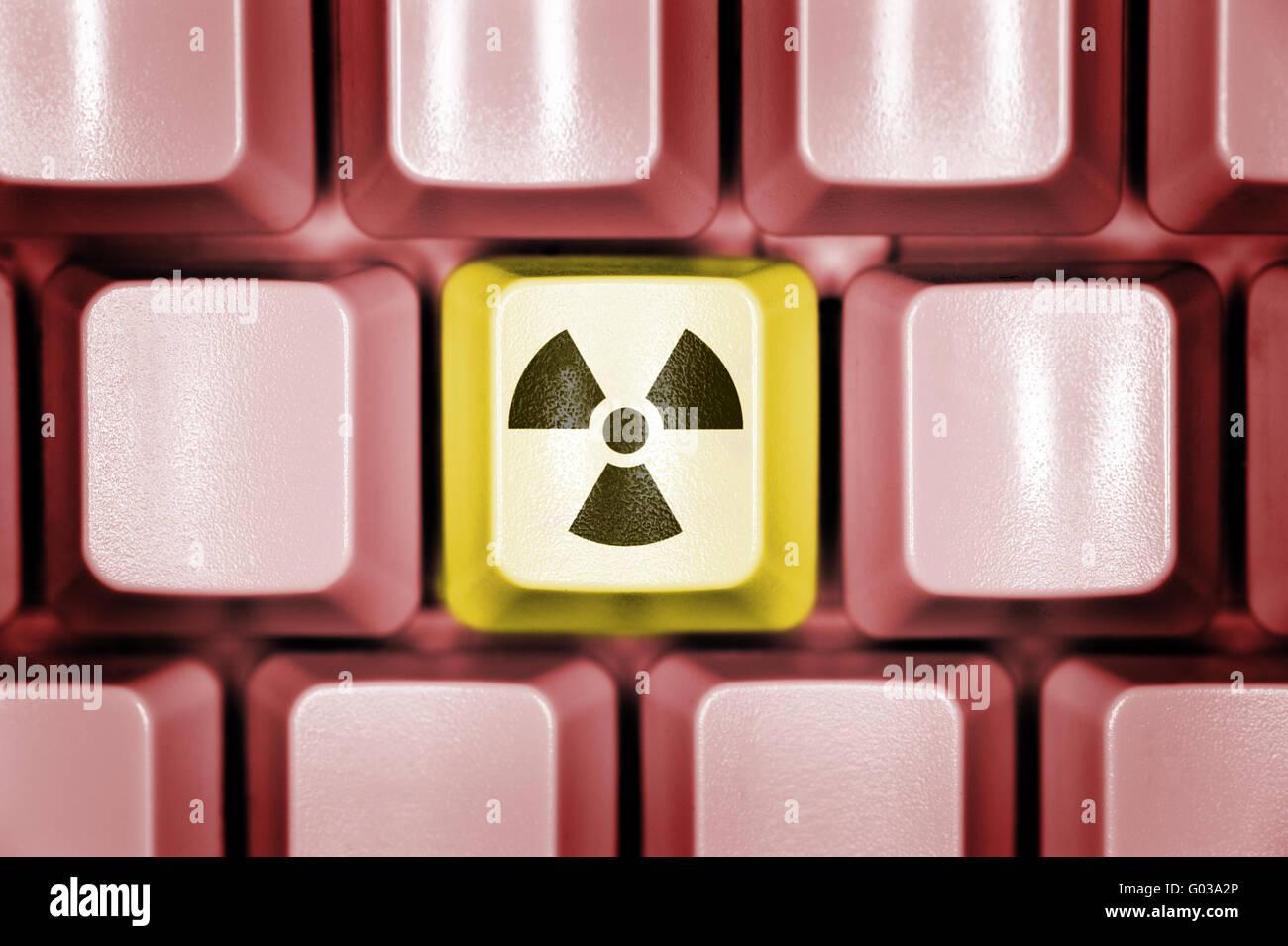 Computer keyboard with radioactivity sign - Stock Image
