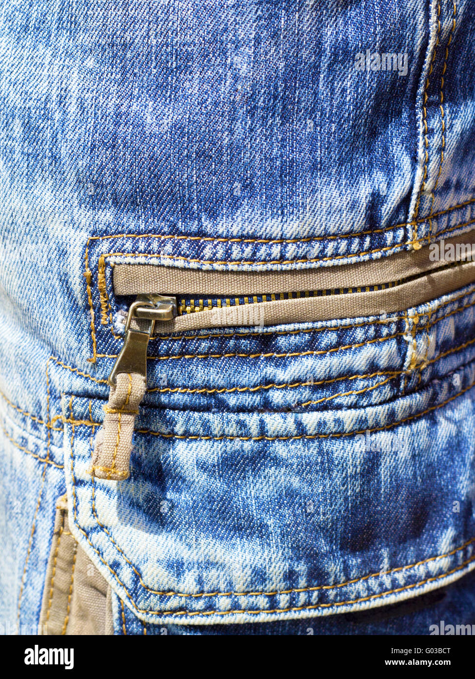 close-up of denim trousers with patch pockets with - Stock Image