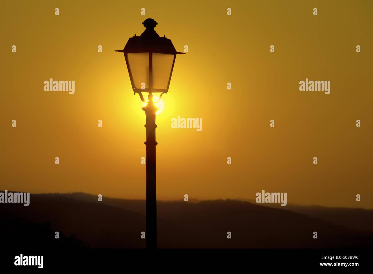 street lantern and sunset, Radda in Chianti, Italy - Stock Image