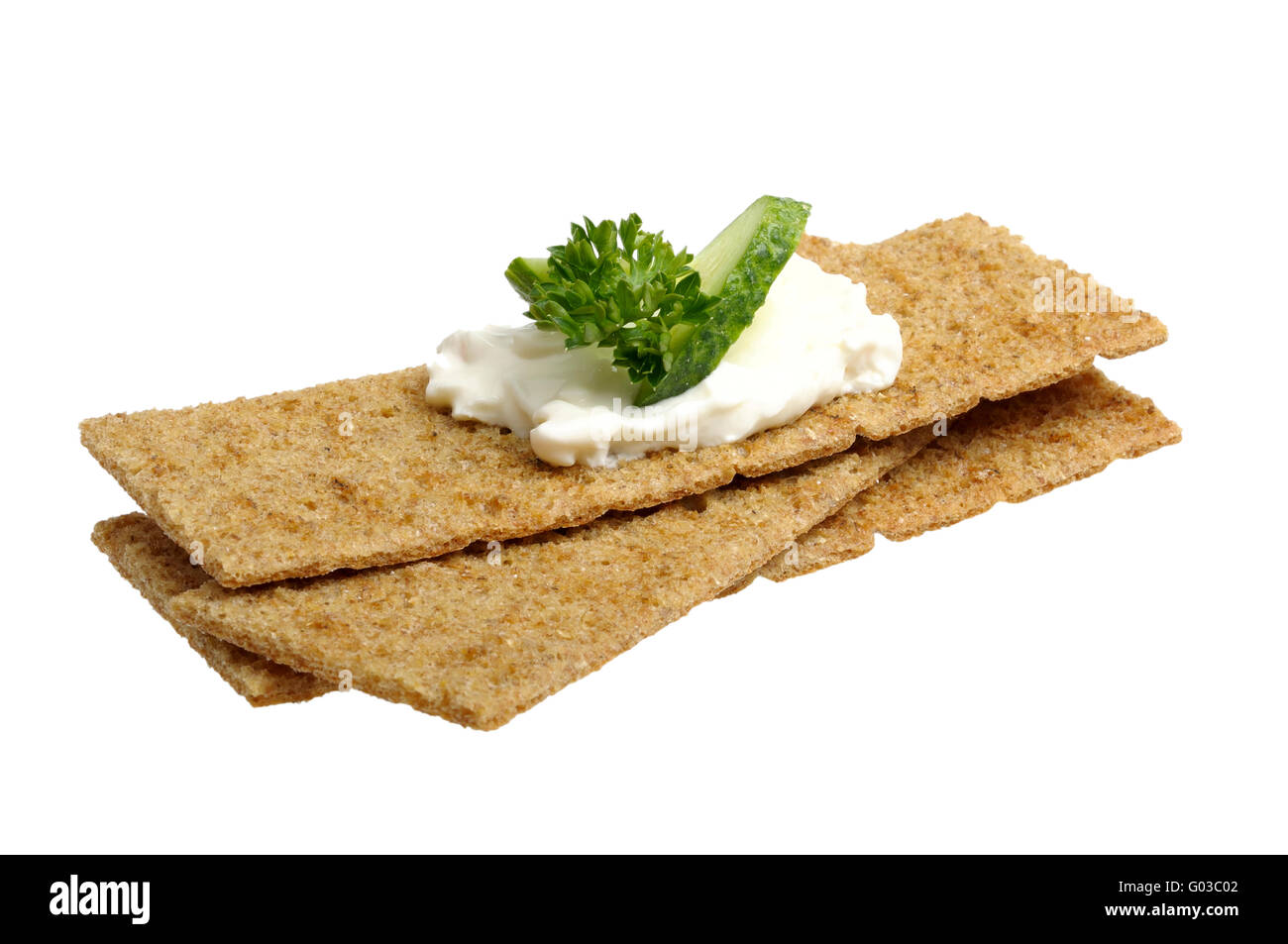 crispbread with curd cheese with cucumber and pars - Stock Image