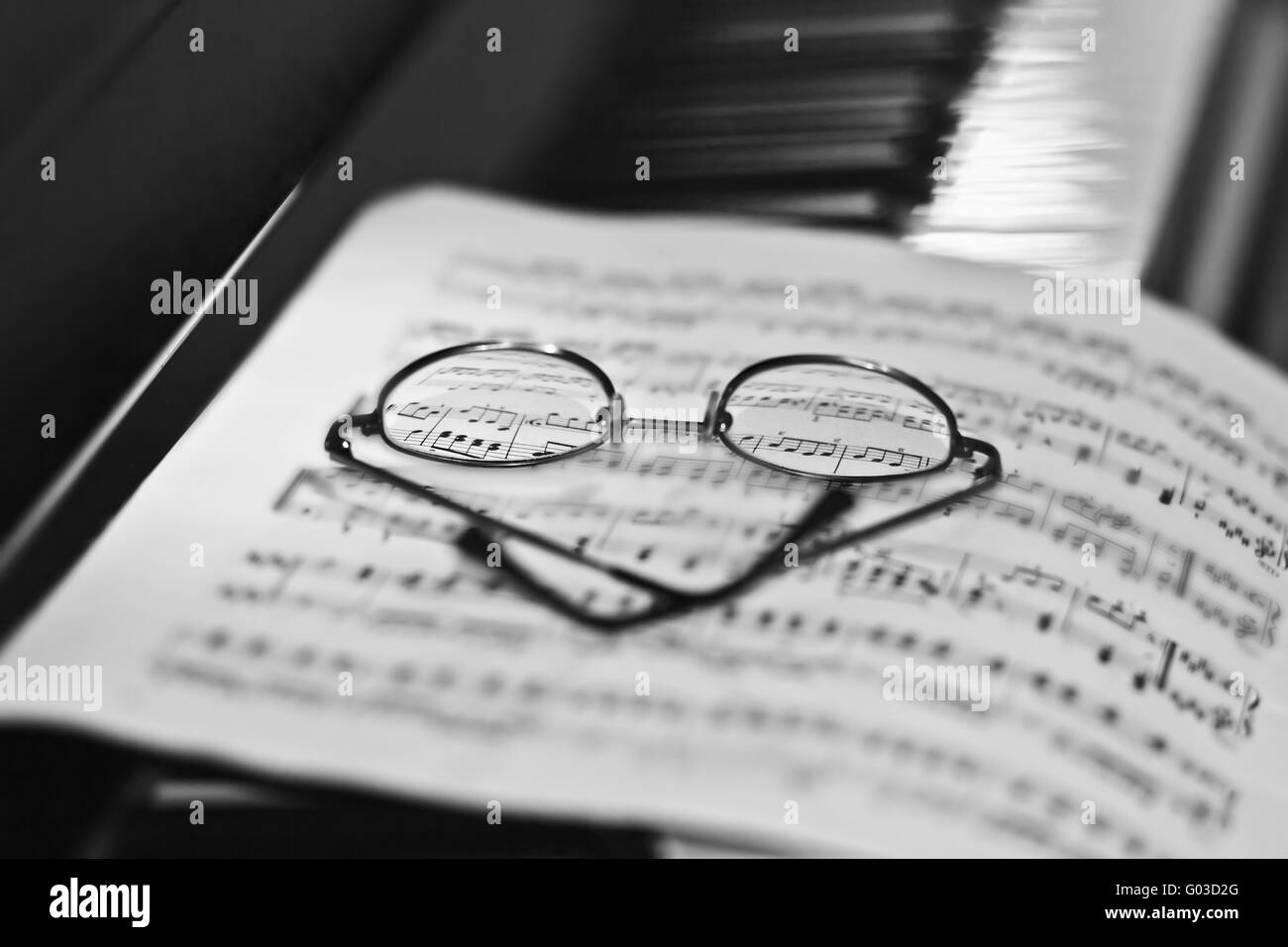 Glasses at sheet of music Stock Photo