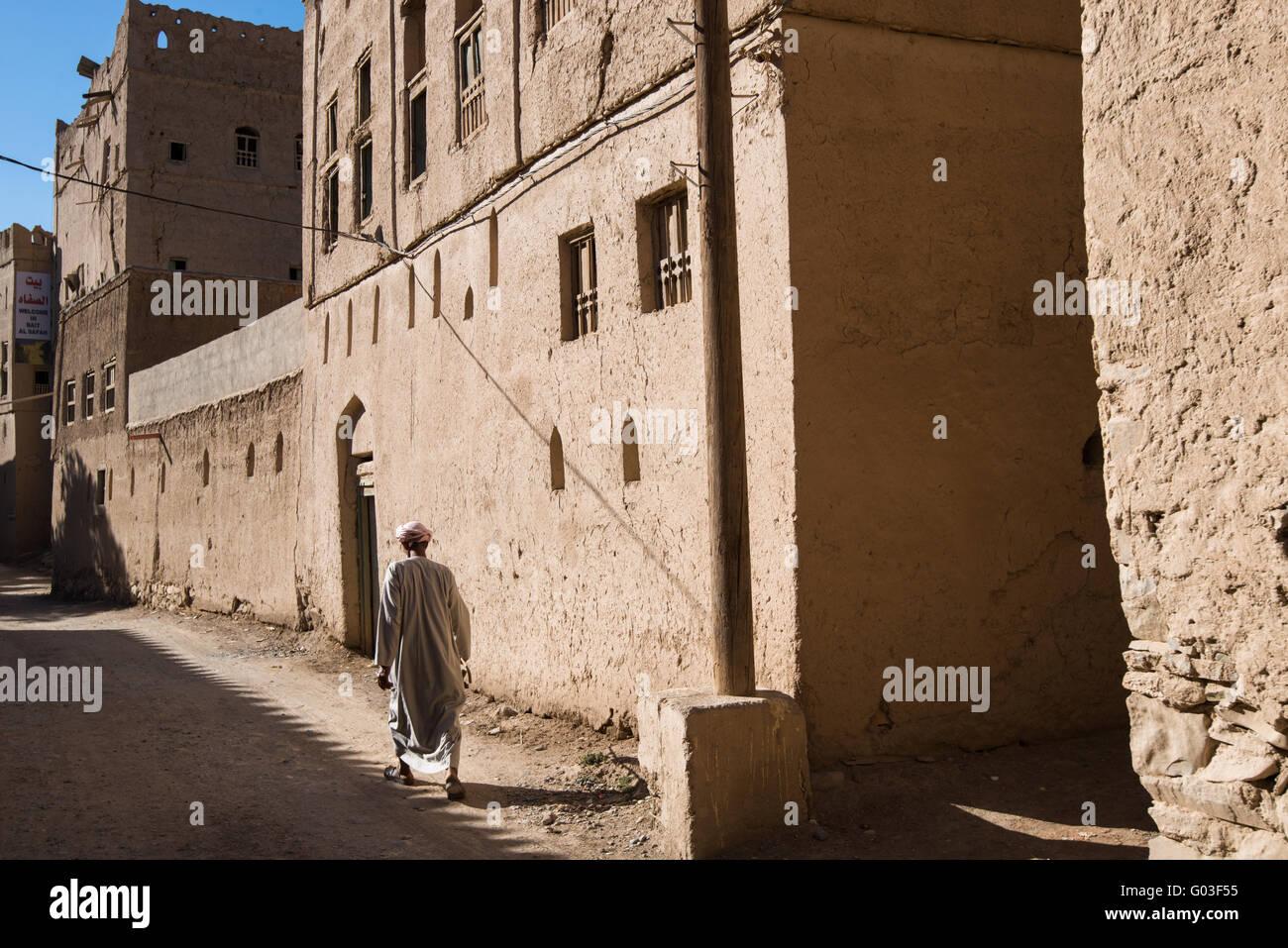 Man walking in the abandoned Al Hamra village, Oman. - Stock Image