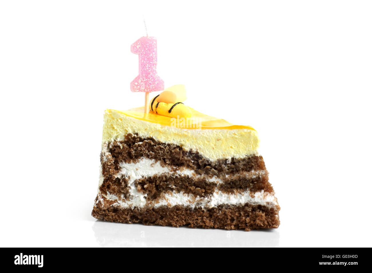Slice Of Cream Birthday Cake With Number One Candle Stock Photo