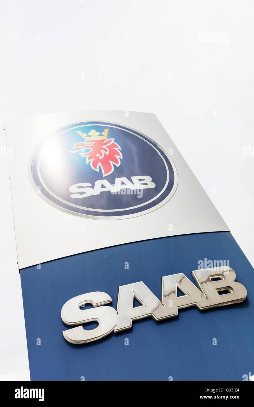 SAAB car dealers sign vehicle name store manufacturers exterior logo UK England advertising board signs garage garages - Stock Image