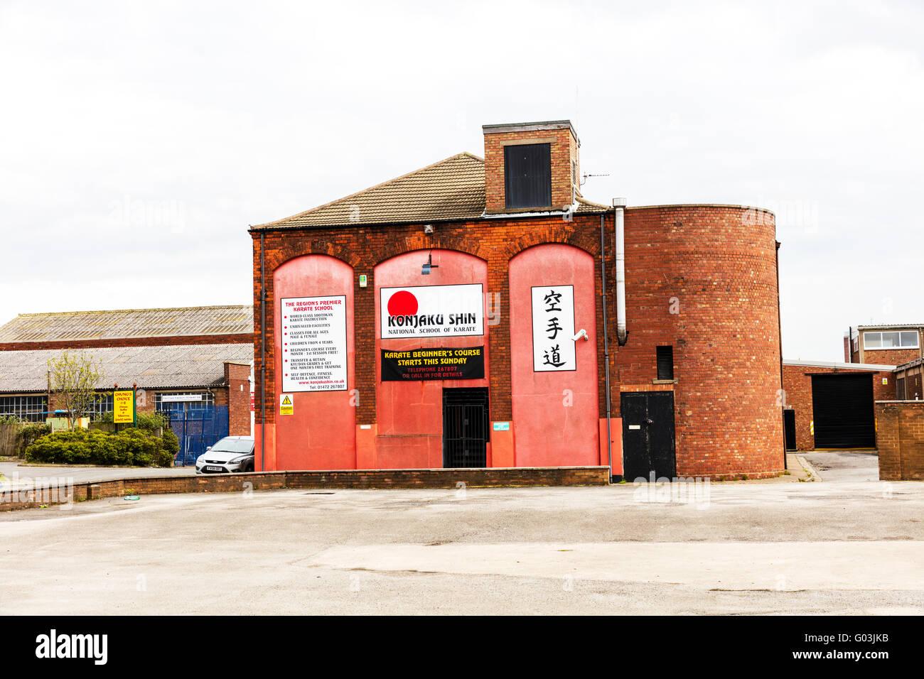 Karate school building signs shop sign name Konjaku Shin exterior logo Grimsby Town UK England - Stock Image
